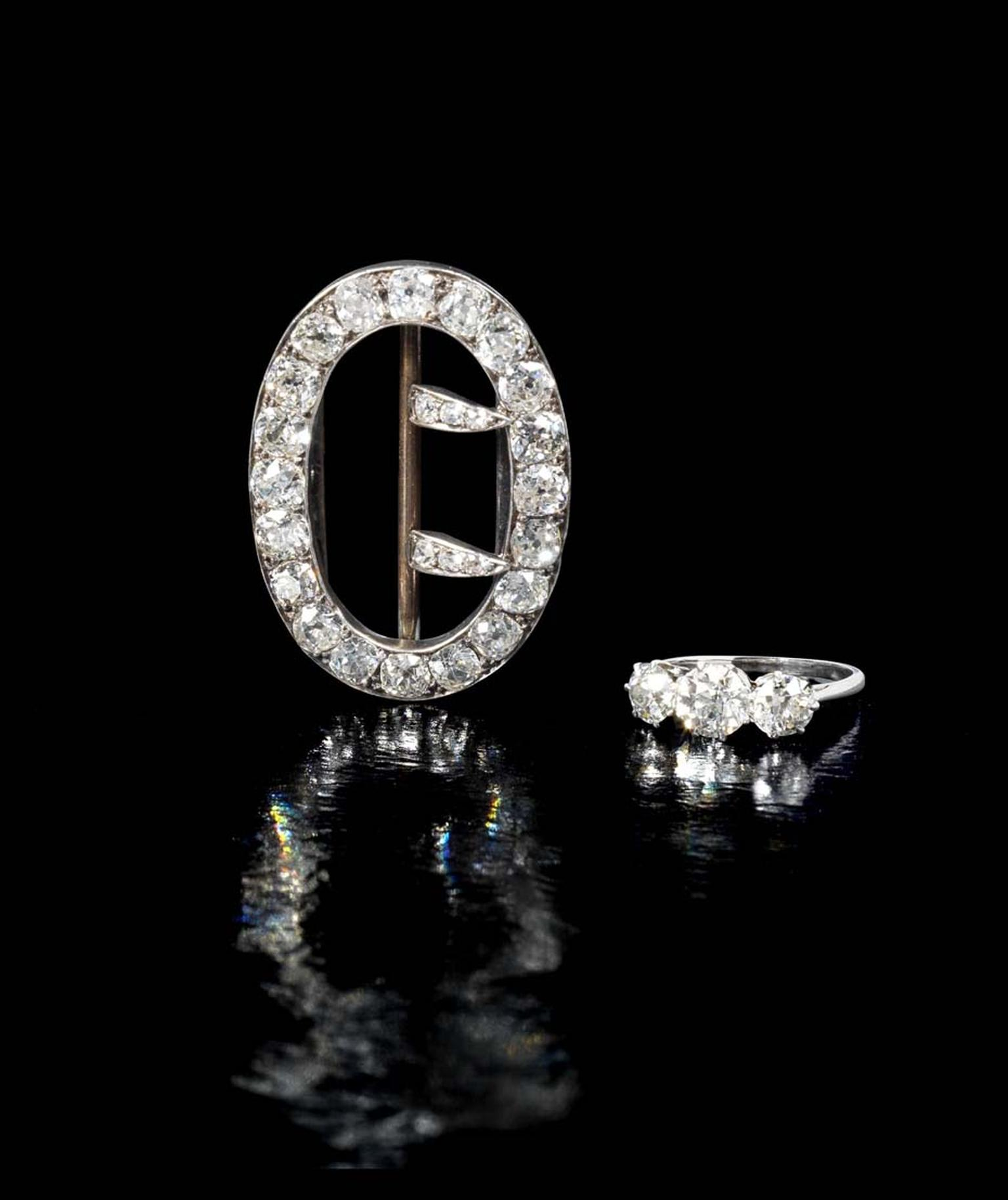 The contents of Agatha Christie's trunk, included a three stone brilliant-cut diamond ring and a diamond brooch in the shape of a buckle, will be auctioned by Bonhams London on 8 October 2014. Bids for the brooch will start at £6,000-8,000 and the ring at