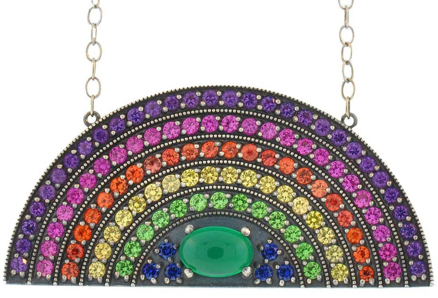 Andrea Fohrman rainbow pendant set with pink, orange, yellow and blue sapphires, amethysts, tsavorites and a green onyx centre.