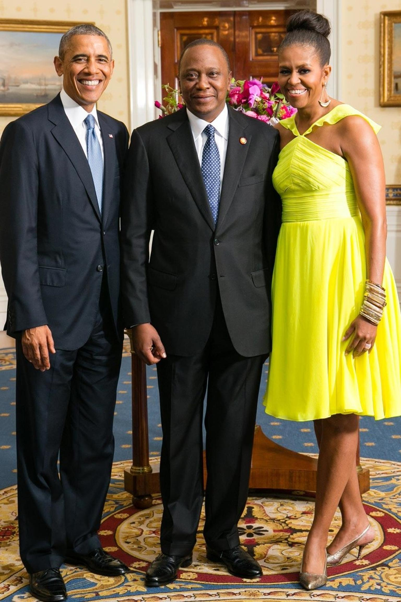 In a symbolic gesture captured in this photograph of the American president and his wife posing with Uhuru Kenyatta - the President of Kenya - the First Lady wore a stack of horn and bronze Nene Bangles by Ashley Pittman, made by artisans in workshops in