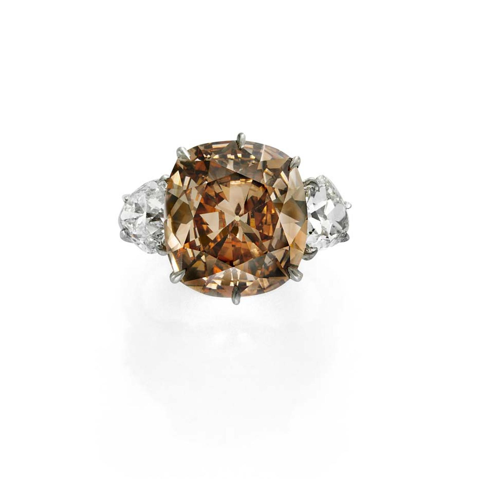 Simon Teakle's 7ct orange-brown diamond ring is flanked by two white diamonds.