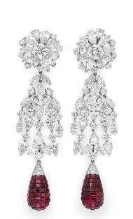 A pair of vintage invisible set ruby and diamond cascade earrings by Van Cleef & Arpels, available at Simon Teakle.