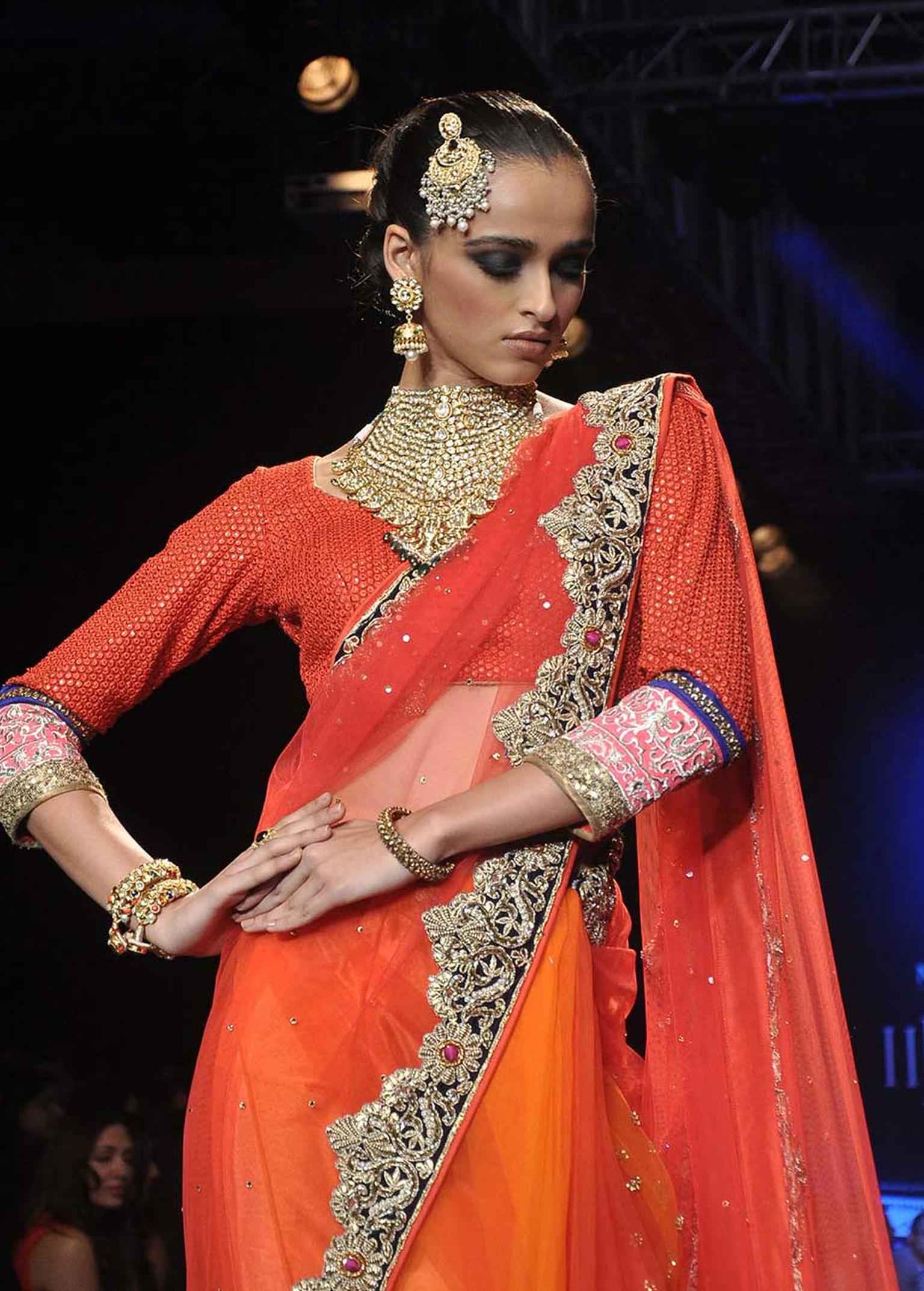 A model showcasing Vijay Golecha's latest collection at International India Jewellery Week 2014.