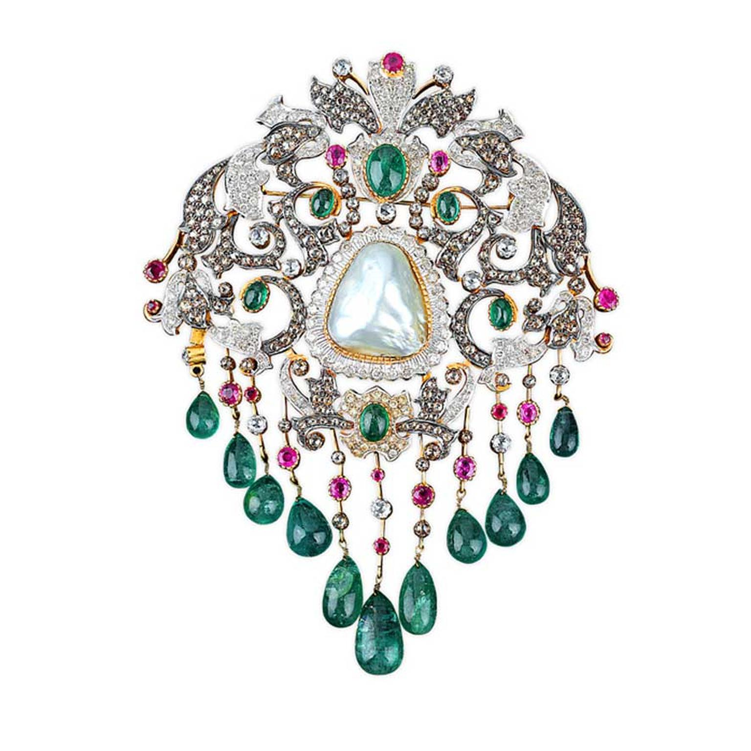 Golecha brooch studded with diamonds, rubies, emeralds and a large central pearl.