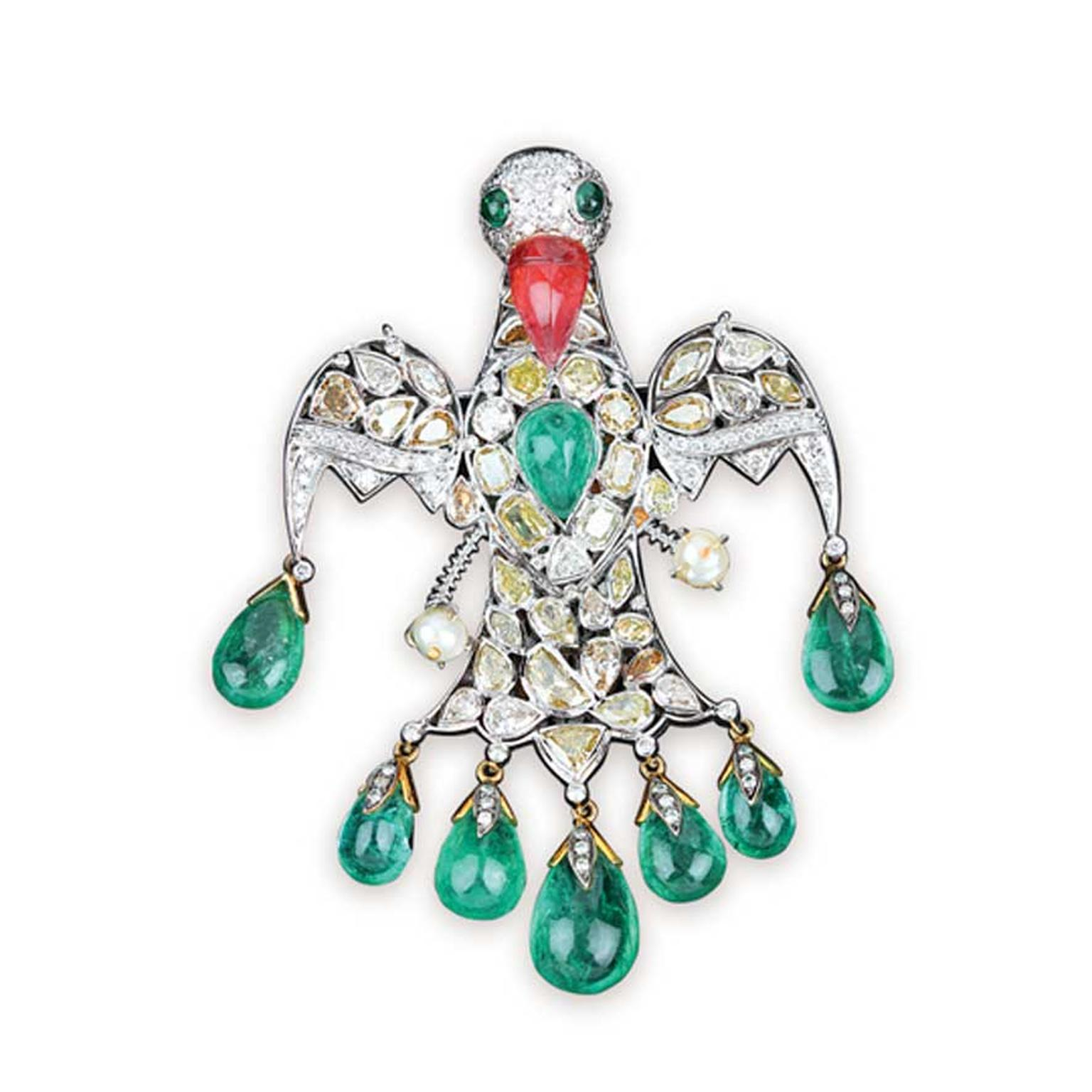 Golecha Bird brooch studded with kundan polki, ruby and emeralds.