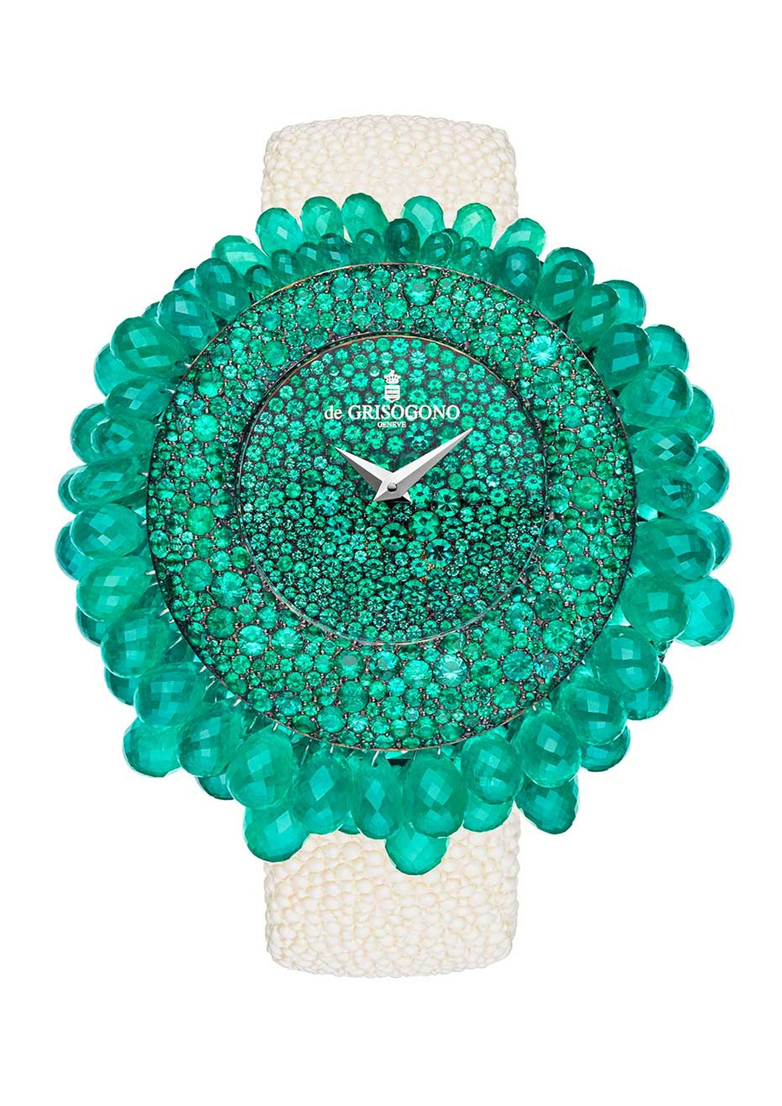 de GRISOGONO's Grappoli watch features emeralds that emanate from the centre of the watch, growing in size and spilling over the bezel in clusters.