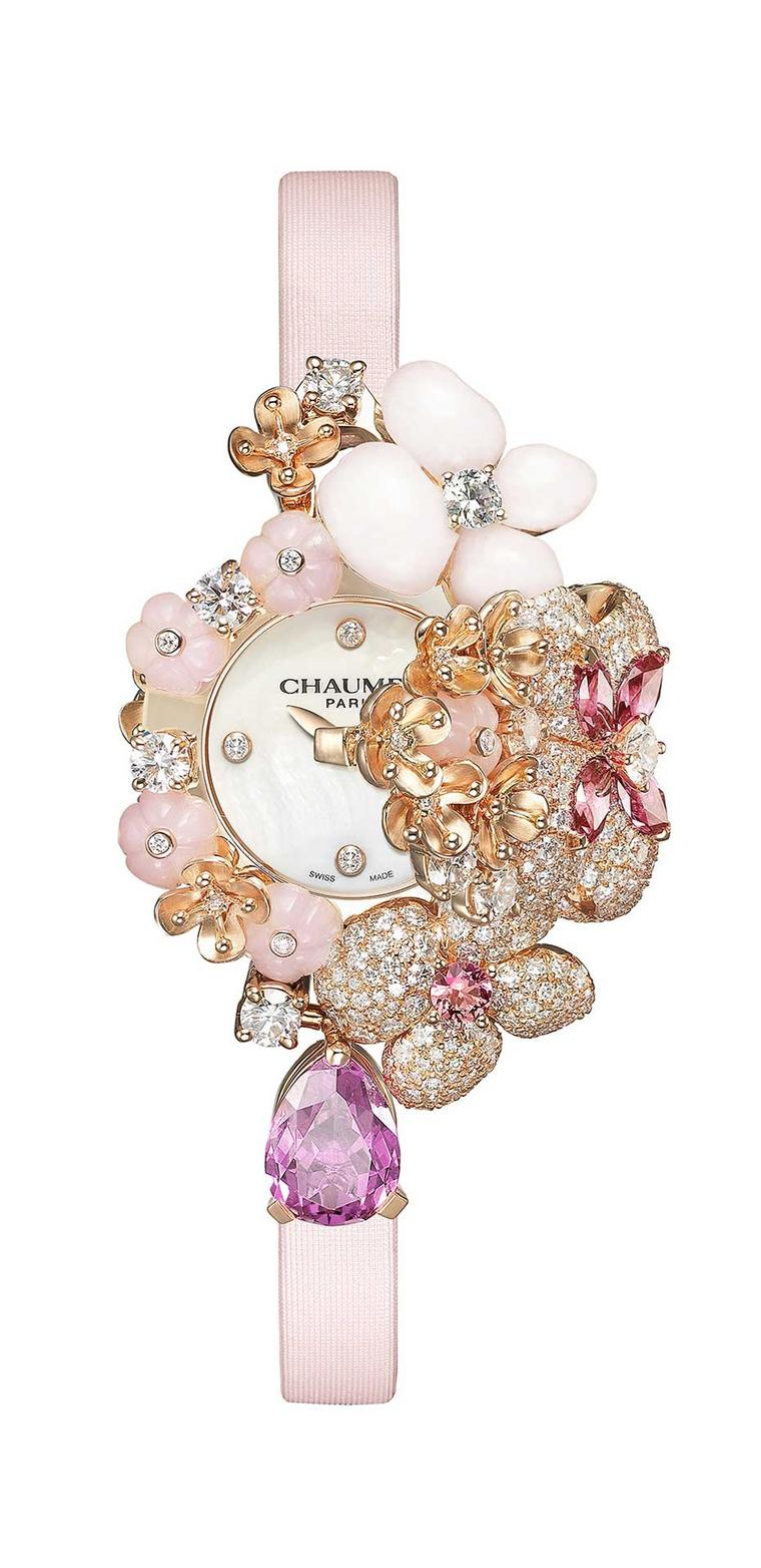 Chaumet's Hortensia Secret jewellery watch features a bouquet of powder-pink flowers sculpted in precious gemstones and set with diamonds and pink sapphires, the hours and minutes slip by on a mother-of-pearl dial.