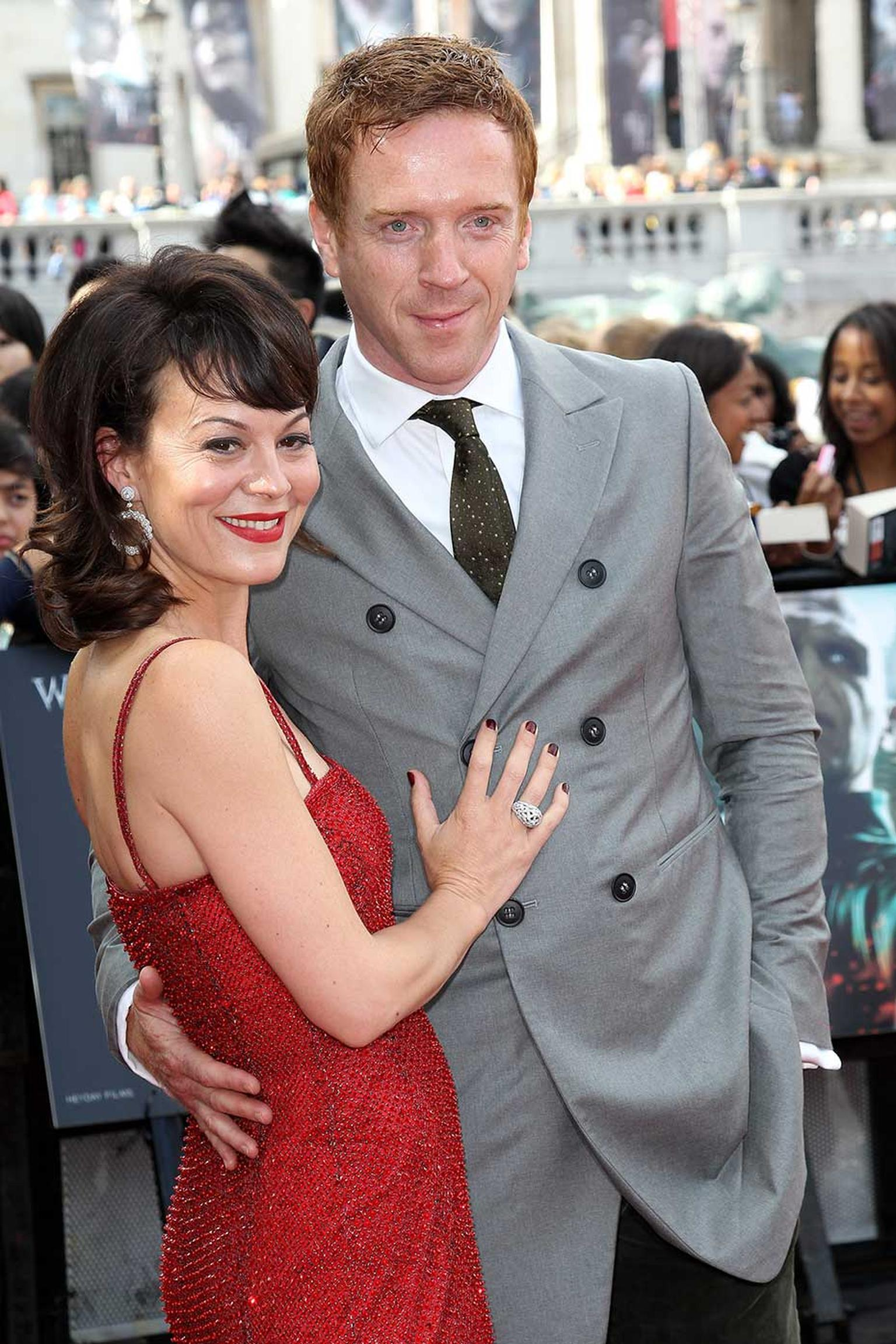 Helen McCrory wearing a David Morris Rose-Cut ring and earrings alongside husband Damian Lewis at the premiere of Harry Potter and the Deathly Hallows.