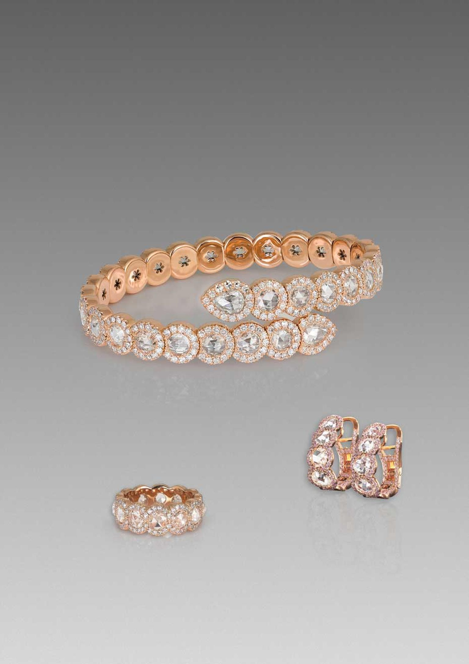 David Morris Rose-Cut collection sprung bangle, three-row eternity band and diamond hoop earrings with rose-cut diamonds, all set in rose gold.