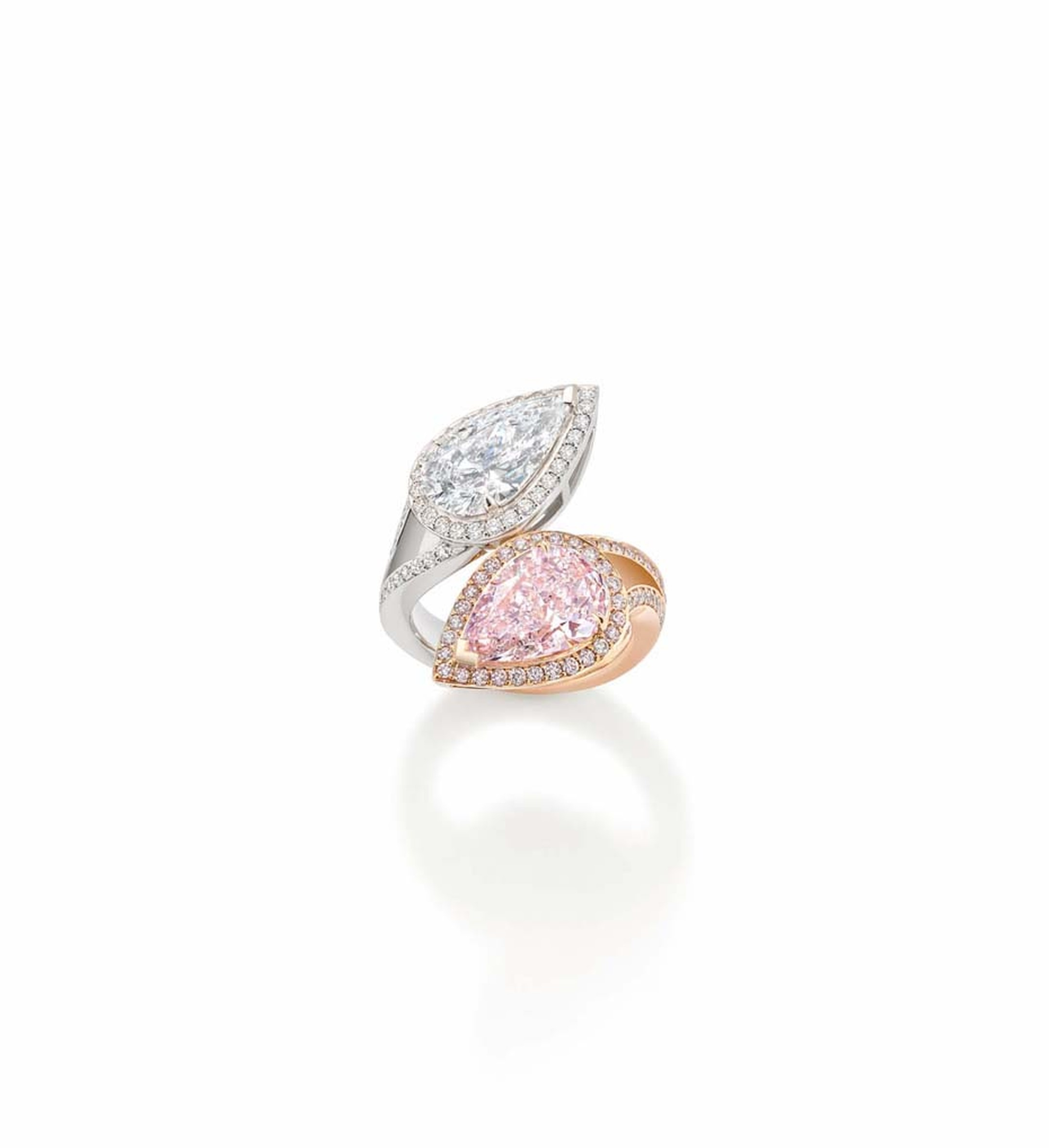 Boodles Gemini collection ring features a natural light pink, pear-shaped diamond on one prong, mirrored by a stunning D colour white diamond on the other.