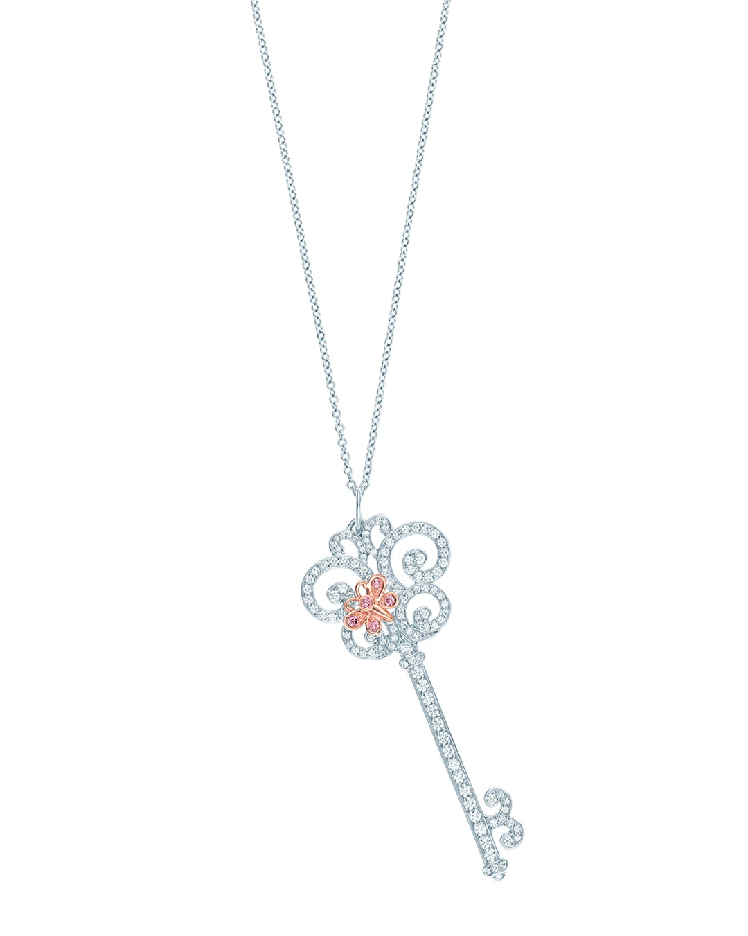 Tiffany Keys Enchant Heart pendant in platinum featuring a pink diamond butterfly set in rose gold perched upon a white diamond key.