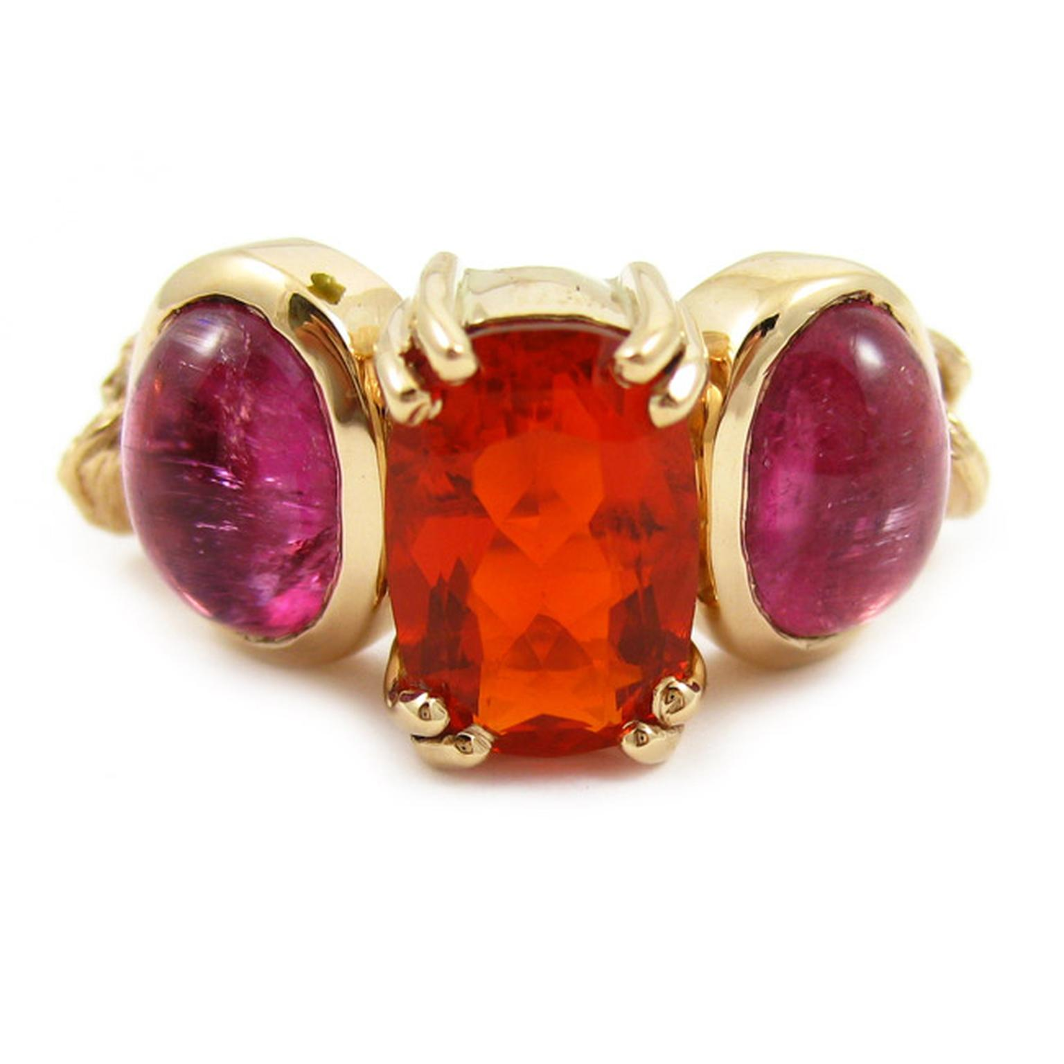 K. Brunini Chains of Love Twig ring in rose gold with a Mexican fire opal centre stone flanked by pink tourmaline cabochons.