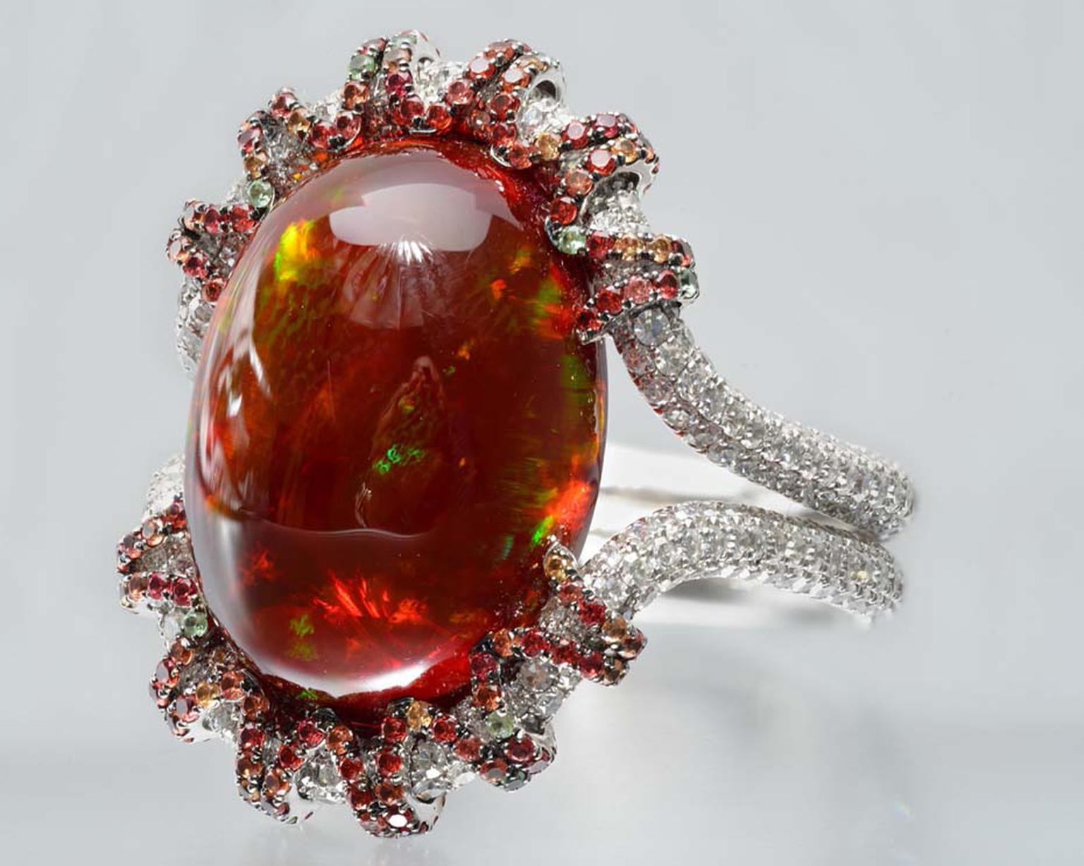 Martin Katz white gold ring with a 13.18ct oval red opal cabochon, microset with diamonds, tsavorite garnets and orange-red sapphires.
