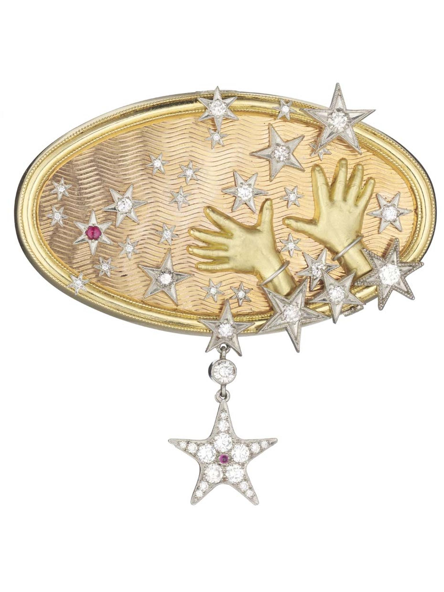 Anthony Lent's Hands to the Stars brooch features diamond-accented stars bursting from tiny hands that are fully realised, right down to the knuckle wrinkles and fingernails.