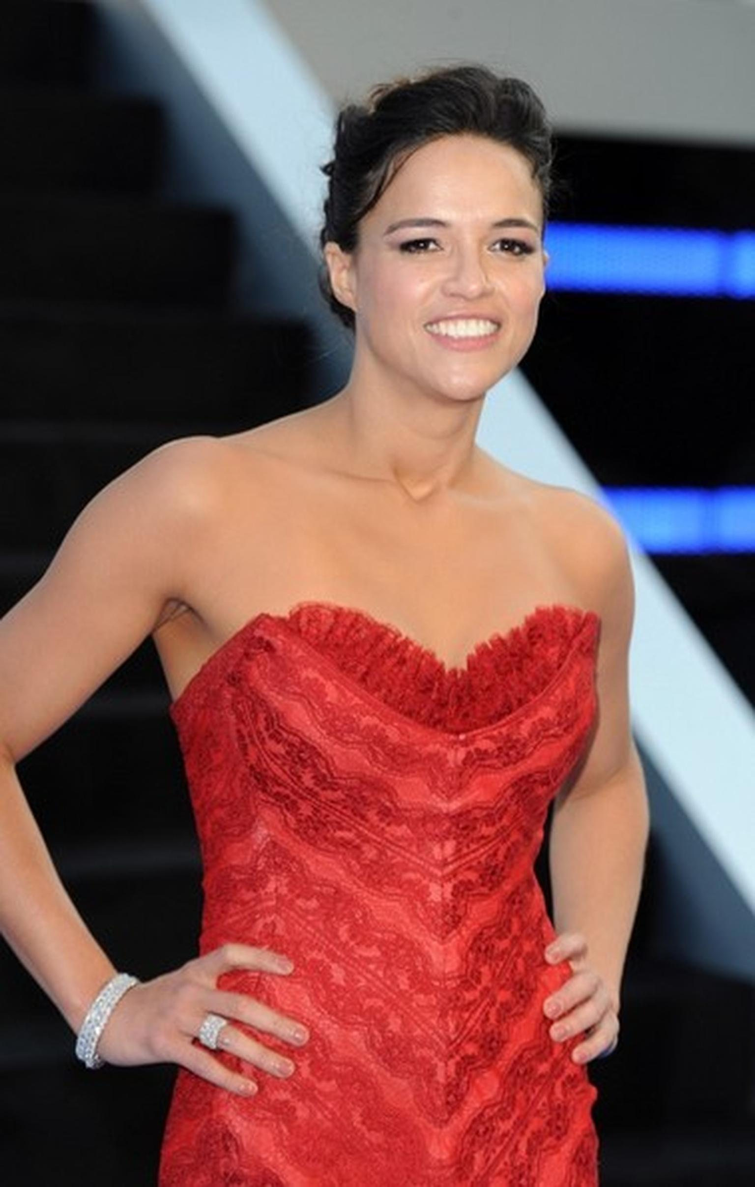 Michelle Rodriguez at the Fast & Furious 6 premier wearing two David Morris Rose-Cut diamond bangles and a matching three row Rose Cut diamond eternity band.