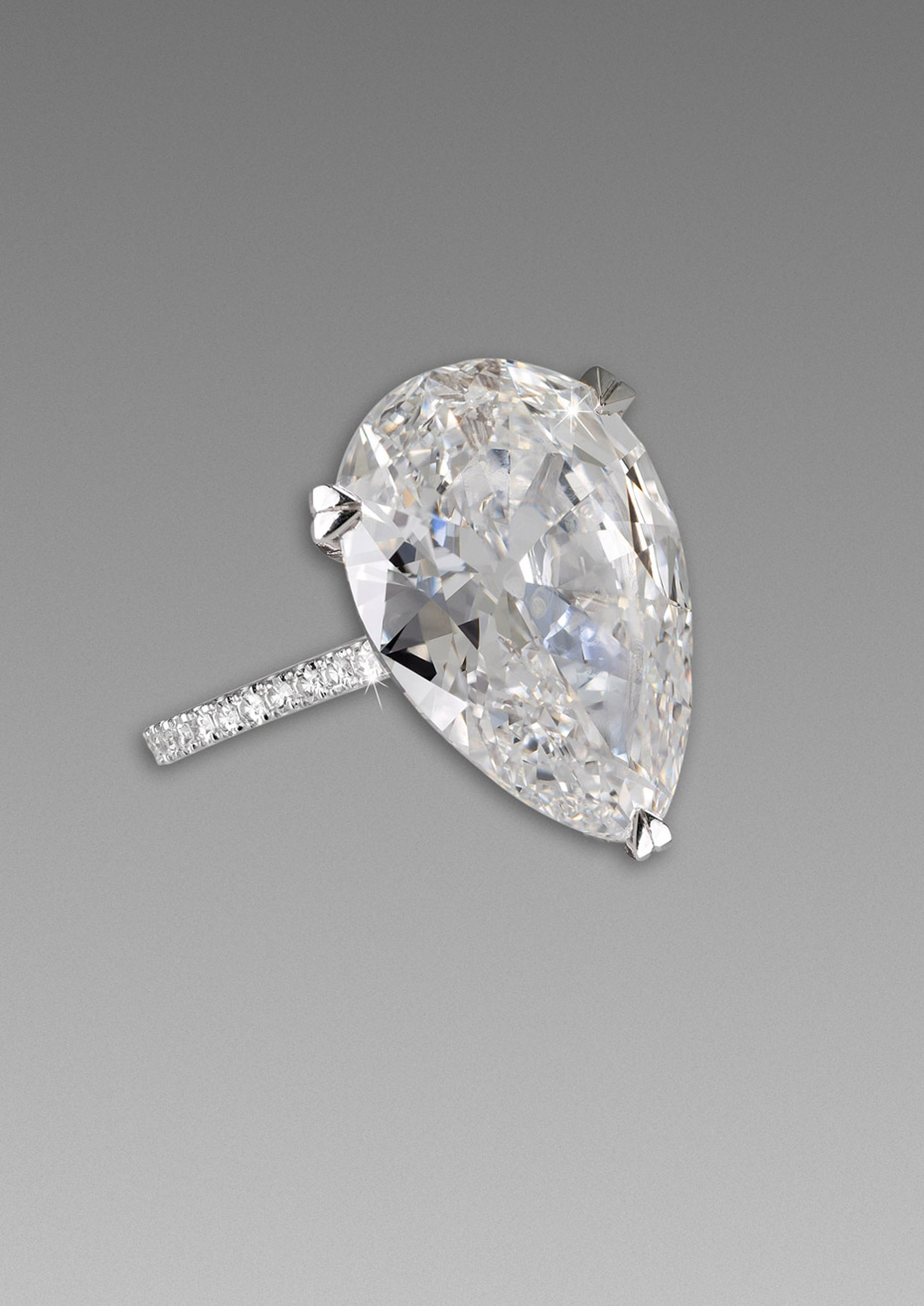 David Morris 8.59ct pear-cut engagement ring with a pavé diamond band.