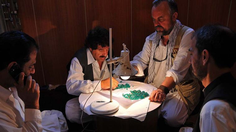 Guy on one of his gem hunting adventures, with an assortment of recently mined emeralds.