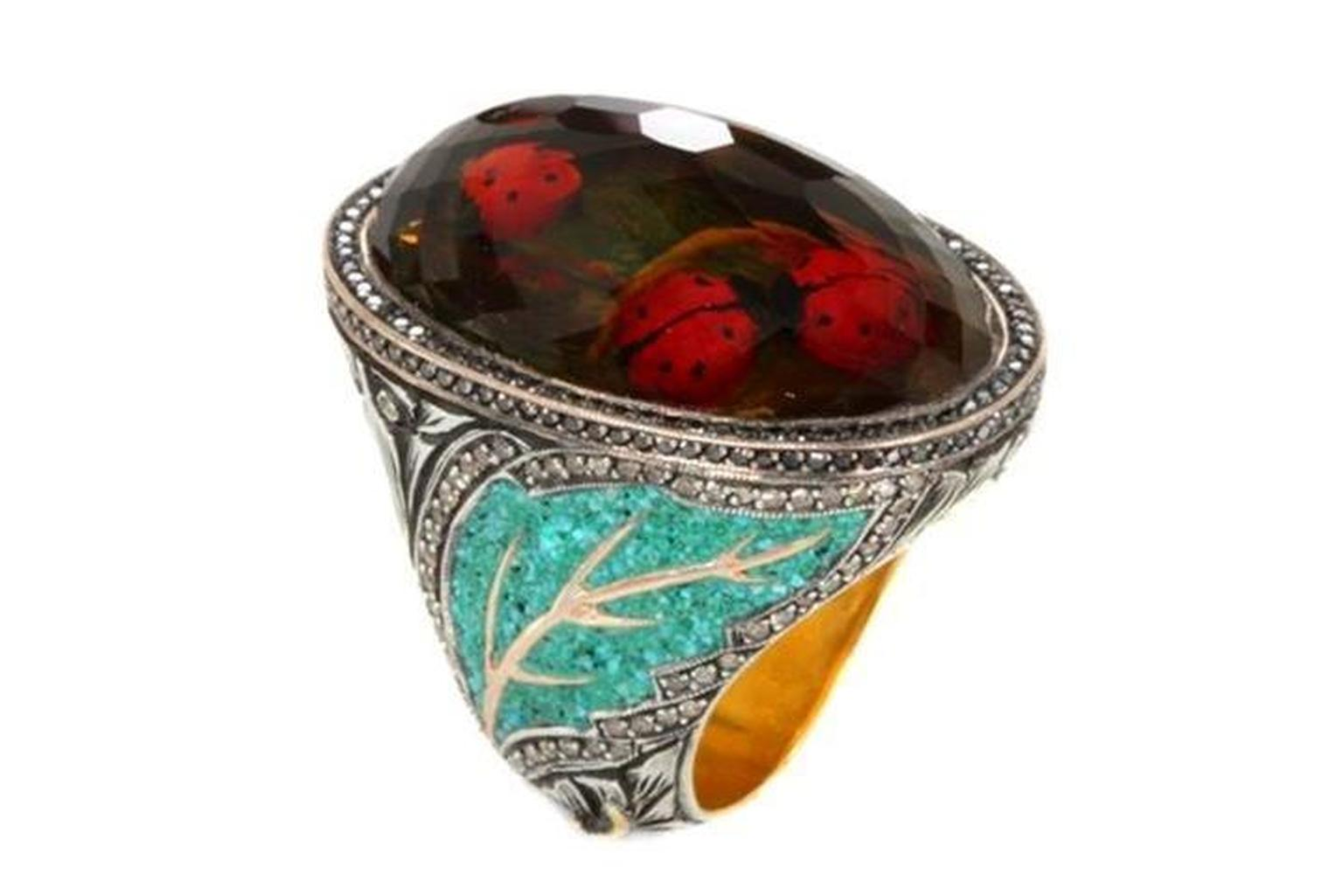 Sevan Biçakçi Ladybird ring with scurrying ladybugs beneath an inversely carved smoky topaz.
