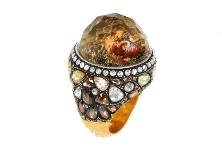 Sevan Biçakçi one-of-a-kind gold and sterling silver ring featuring an inversely carved topaz centre stone reflecting a lion surrounded by coloured diamonds.