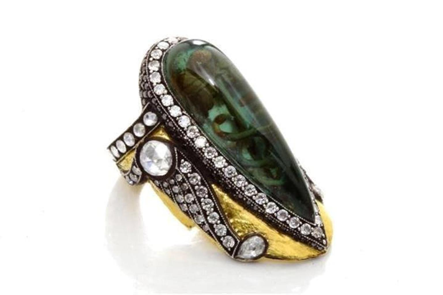Sevan Biçakçi one-of-a-kind gold and sterling silver ring featuring an inversely carved green tourmaline centre stone with an intaglio inscription surrounded by diamonds.