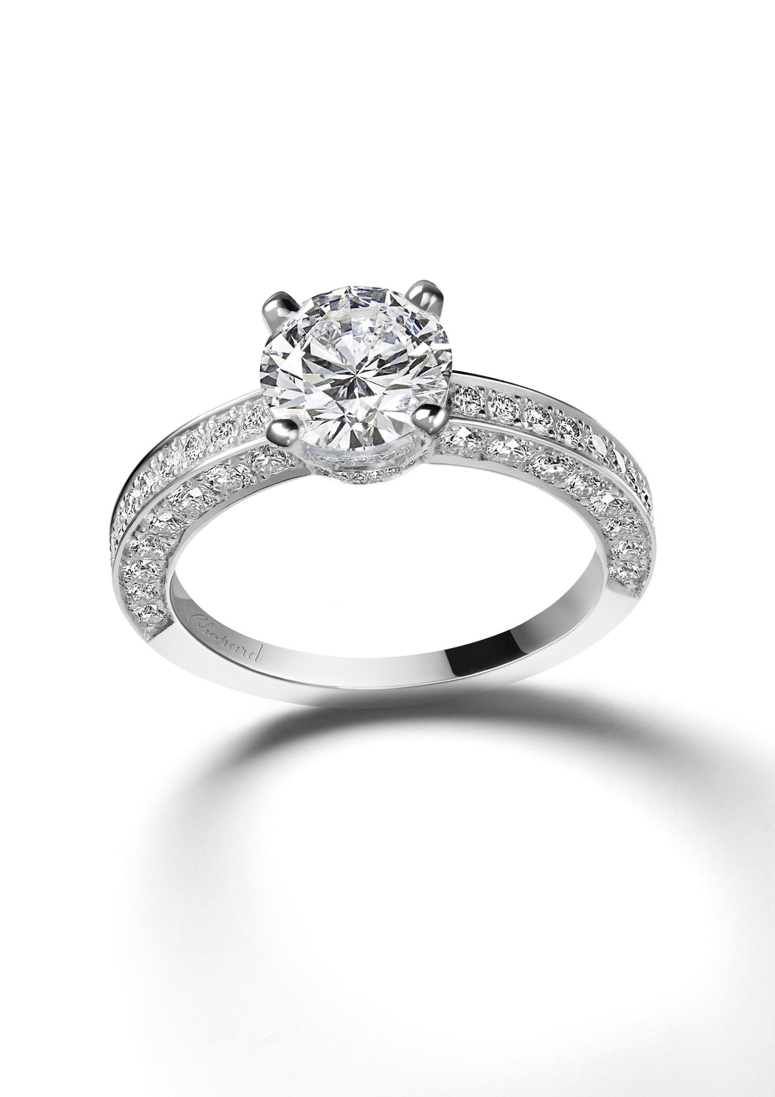 Chopard Passion for Happiness collection white gold solitaire diamond ring featuring an additional swath of diamonds along the tops and sides of the band.