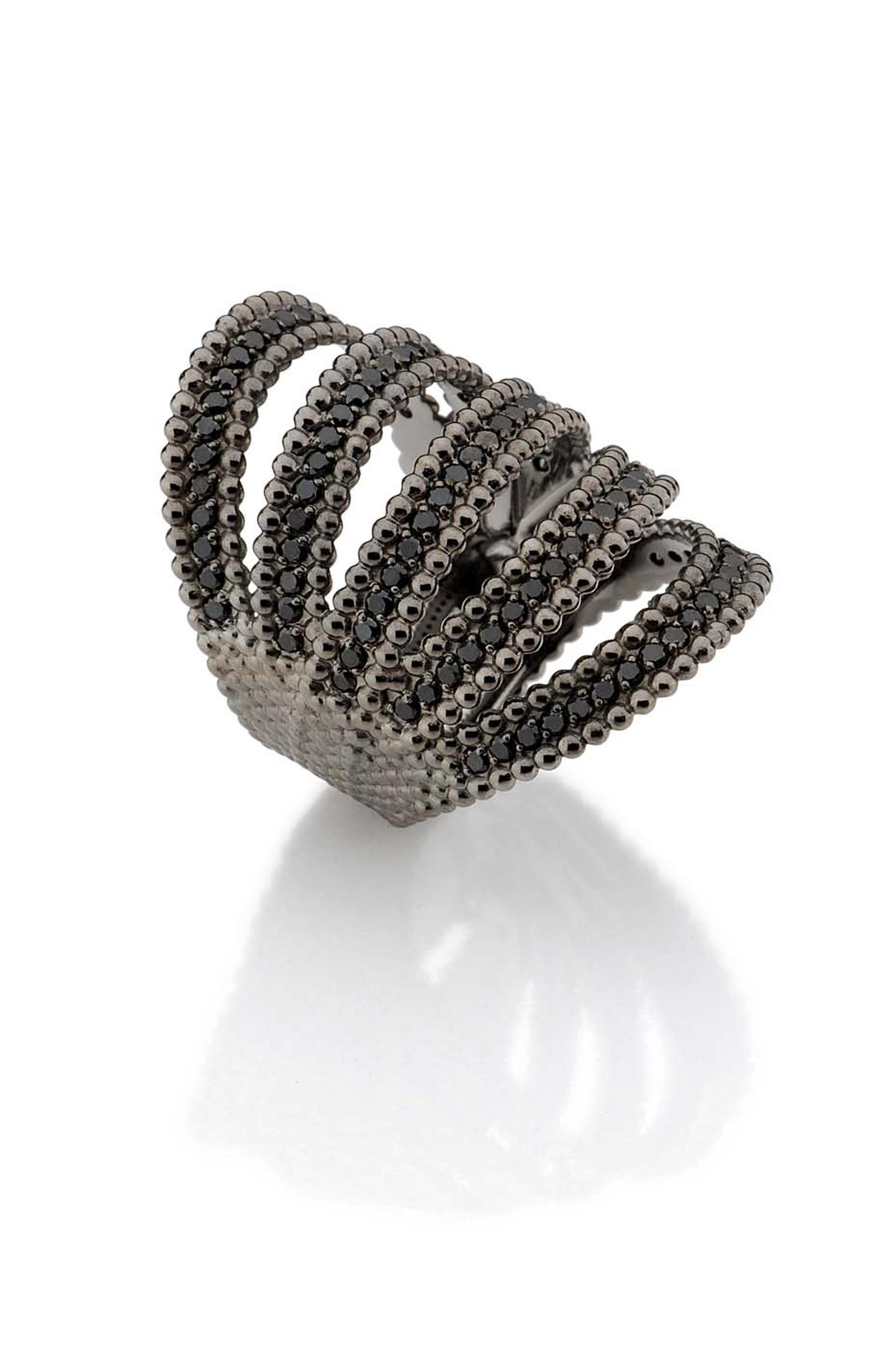 Carla Amorim Fountain black diamond ring set in black gold.