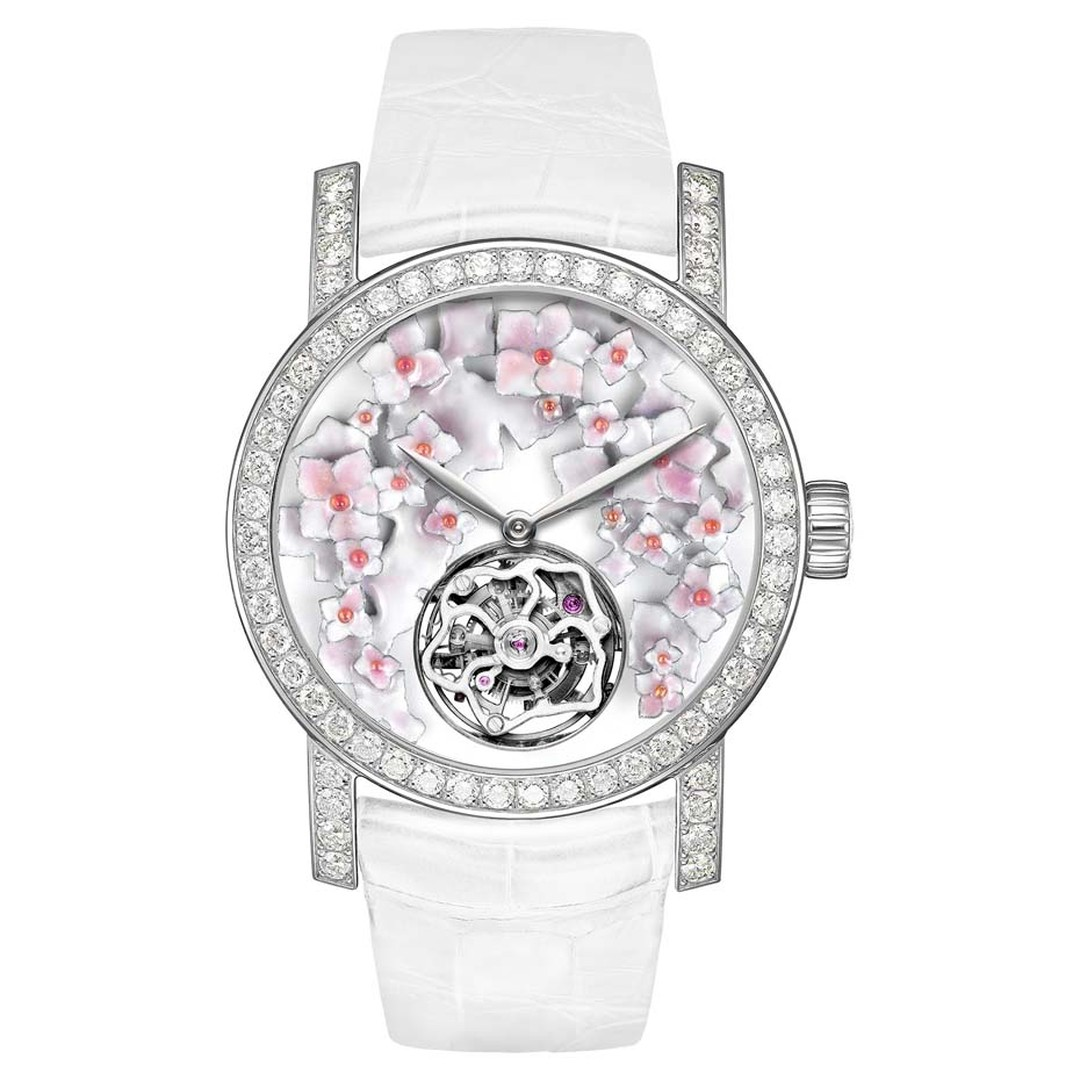 Chaumet's Hortensia Tourbillon watch features a round dial with a grand feu enamel background and hand-sculpted and engraved flowers, illuminated by diamonds on the bezel and lugs.