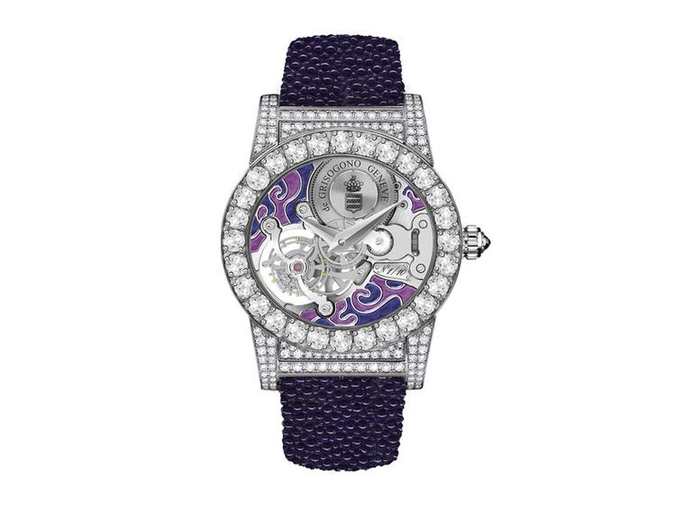 de GRISOGONO's Tondo Tourbillon Gioiello watch features a skeleton dial, with the tourbillon in full view enhanced by a swirly purple enamelled background. Large white diamonds decorate the oval-shaped case and lugs, which contrast with the hot purple gal