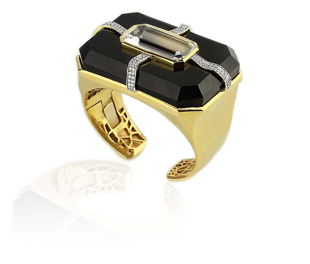Kara Ross' Cava cuff features rock crystal inset black onyx, held in place by four ribbons of sparkling diamonds.