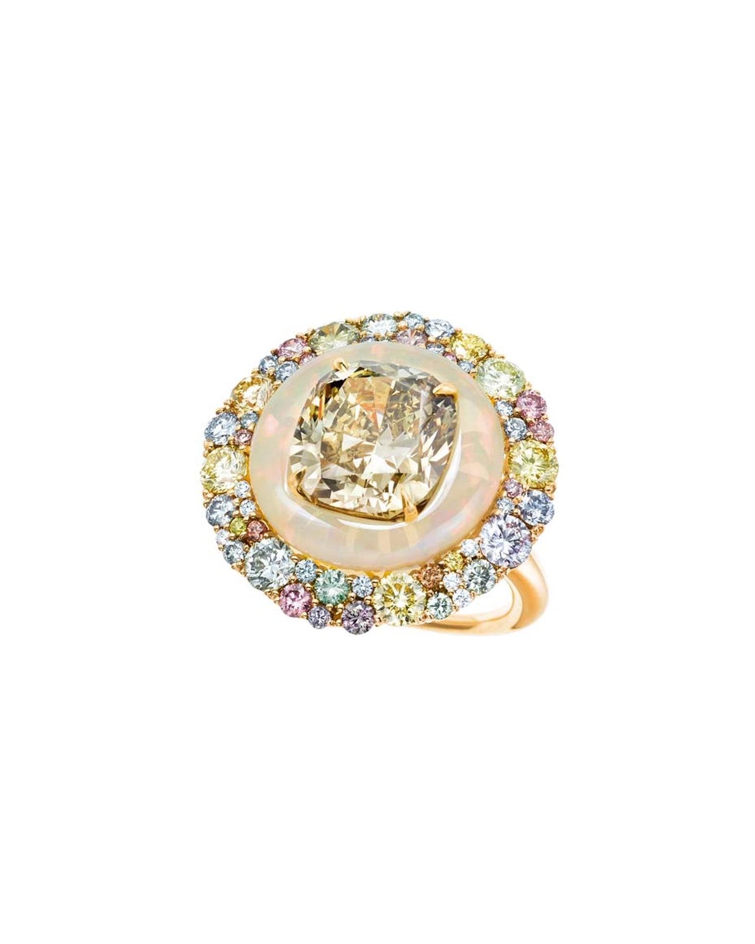 The deep brownish greenish yellow diamond in Tiffany & Co.'s ring is inlaid into an opal encircled by a swath of coloured diamonds.