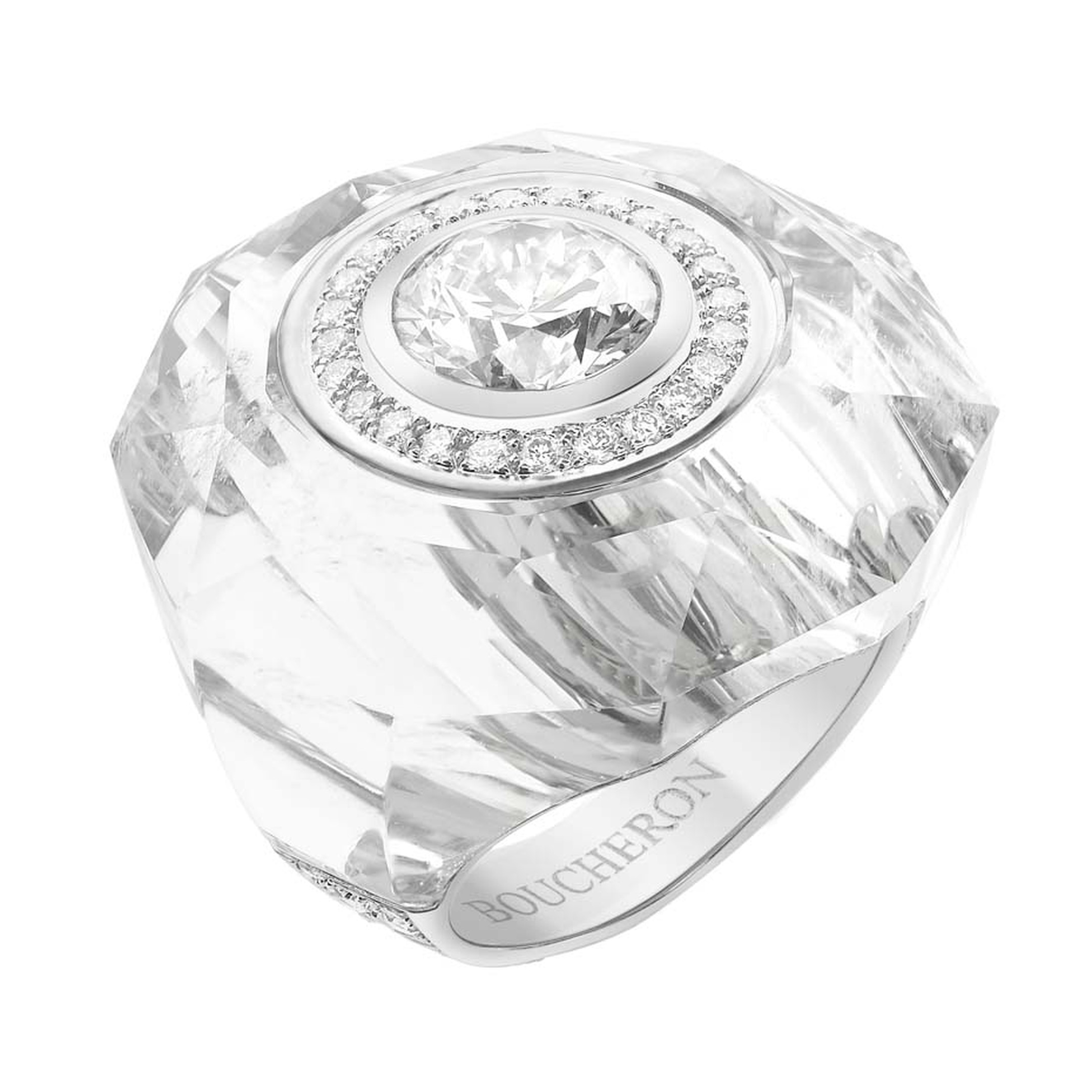 Another Boucheron Trésor de Perse ring features an inlaid diamond set into carved rock crystal, surrounded by diamonds.