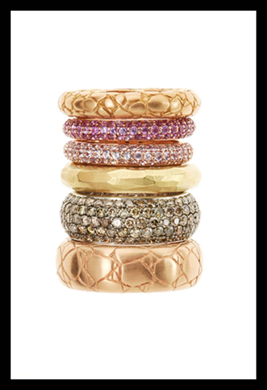Elena Carrera pink and yellow gold rings featuring white and brown diamonds.