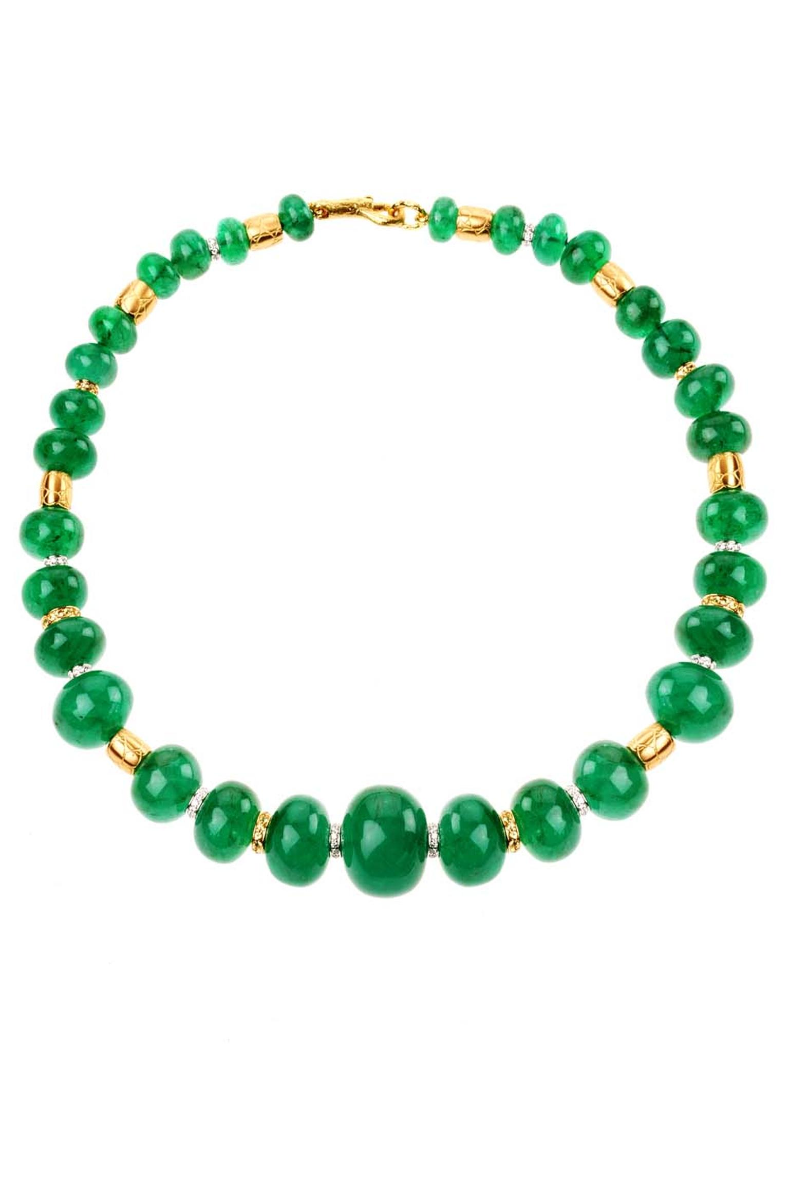Elena C one-of-a-kind emerald necklace with gold coconut textured barrels and diamonds (56,950€).