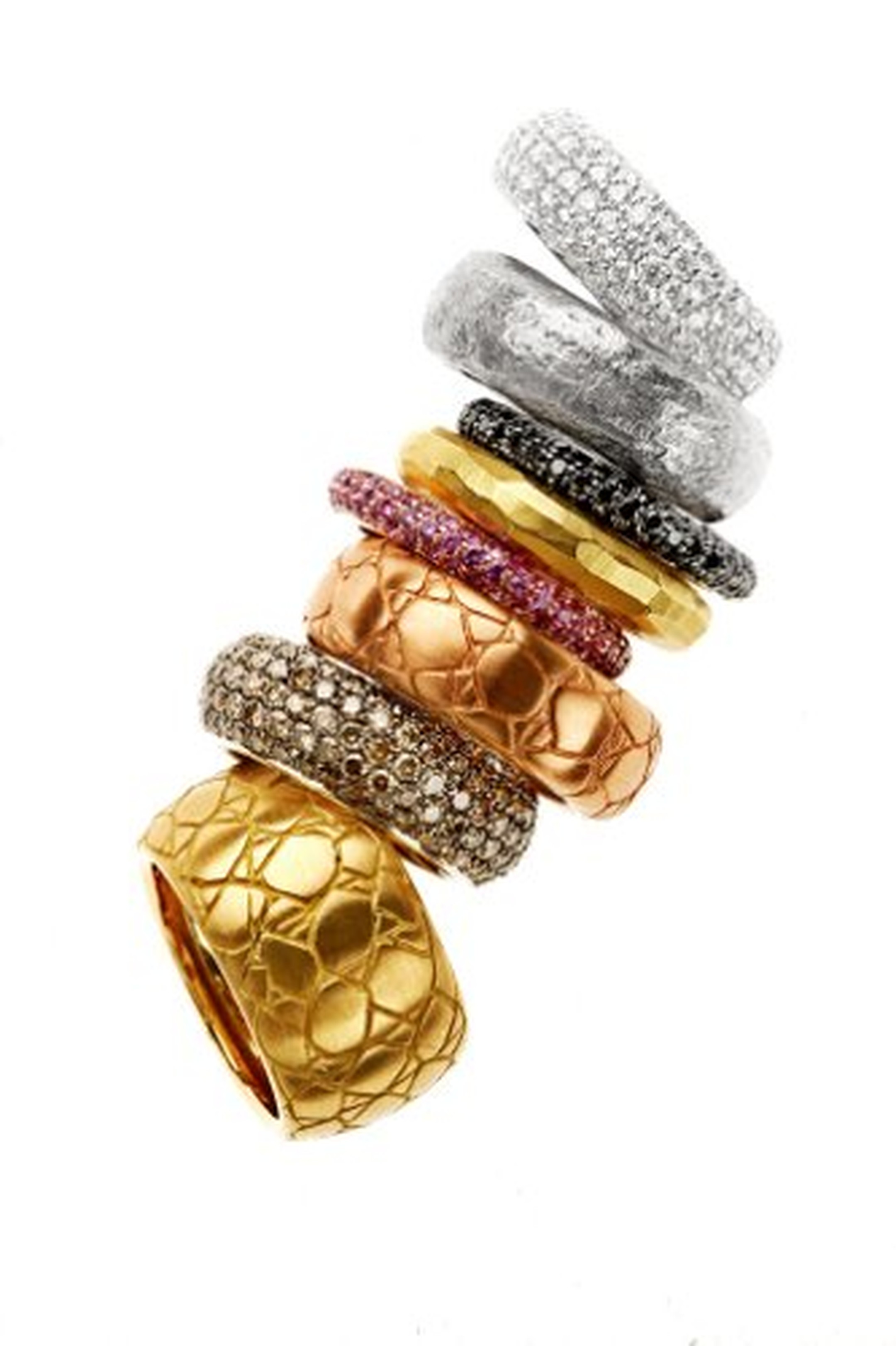 Elena C rings from the Texturas collection in pink, white and yellow gold with crocodile, bamboo and hemp textures as well as brown diamond and coloured sapphires. Prices start at 780€.