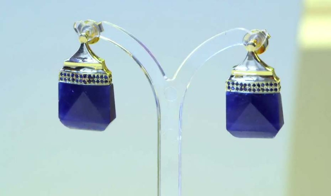 Jade Jagger Never Ending jewellery collection earrings with blue sapphires. Available at 1stdibs.com.