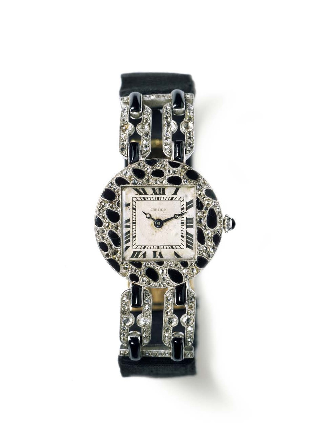 Cartier 1914 wristwatch with panther-spots motif features a round case in polished platinum, paved with rose-cut diamonds and onyx. Image by: Tania & Vincent © Cartier.