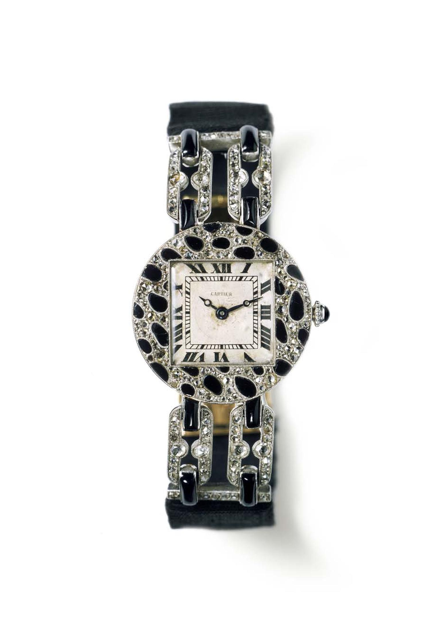 Cartier 1914 wristwatch with panther-spots motif features a round case in polished platinum, paved with rose-cut diamonds and onyx.