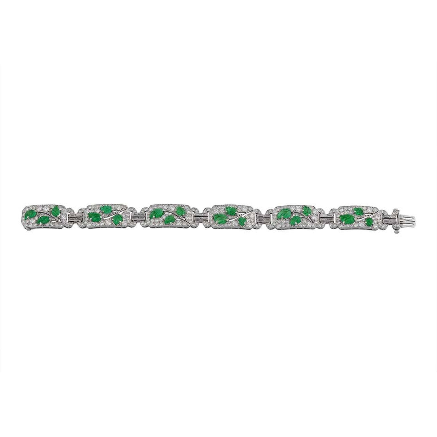 Morelle Davidson vintage Cartier bracelet in platinum with six diamond-pavéd openwork sections, each with three carved emerald leaves forming a branch with baguette diamond-set double links.