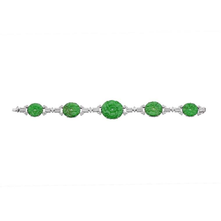 Morelle Davidson antique Cartier bracelet with circular carved jadeite discs alternating with five articulated geometric sections, four baguette diamonds, one navette diamond and 12 small single-cut diamonds.