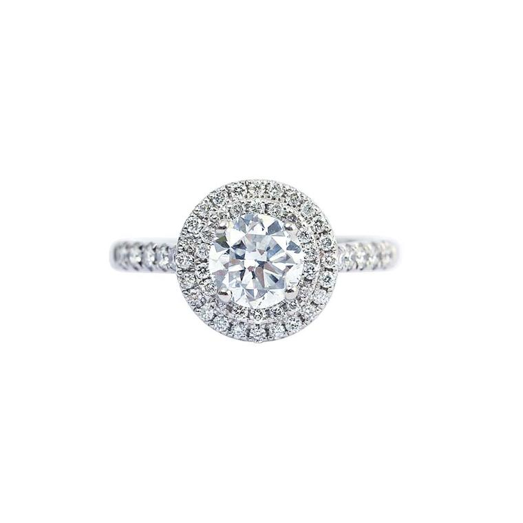 Gee Woods' finished diamond engagement ring featuring a brilliant-cut diamond surrounded by a melée of diamonds.