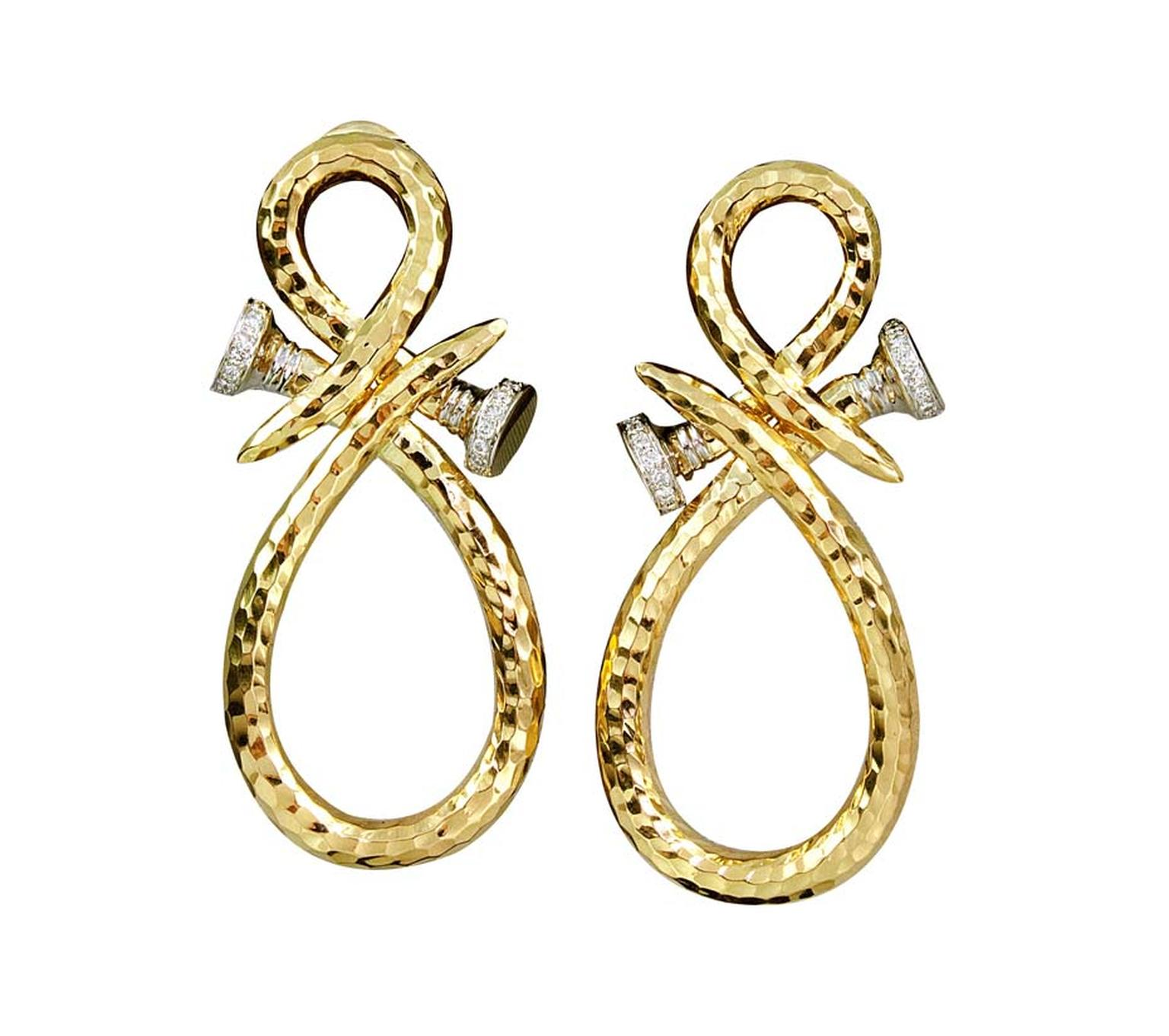 David Webb Tool Chest Collection Curved Nail earrings with brilliant-cut diamonds in hammered gold and platinum ($23,800).