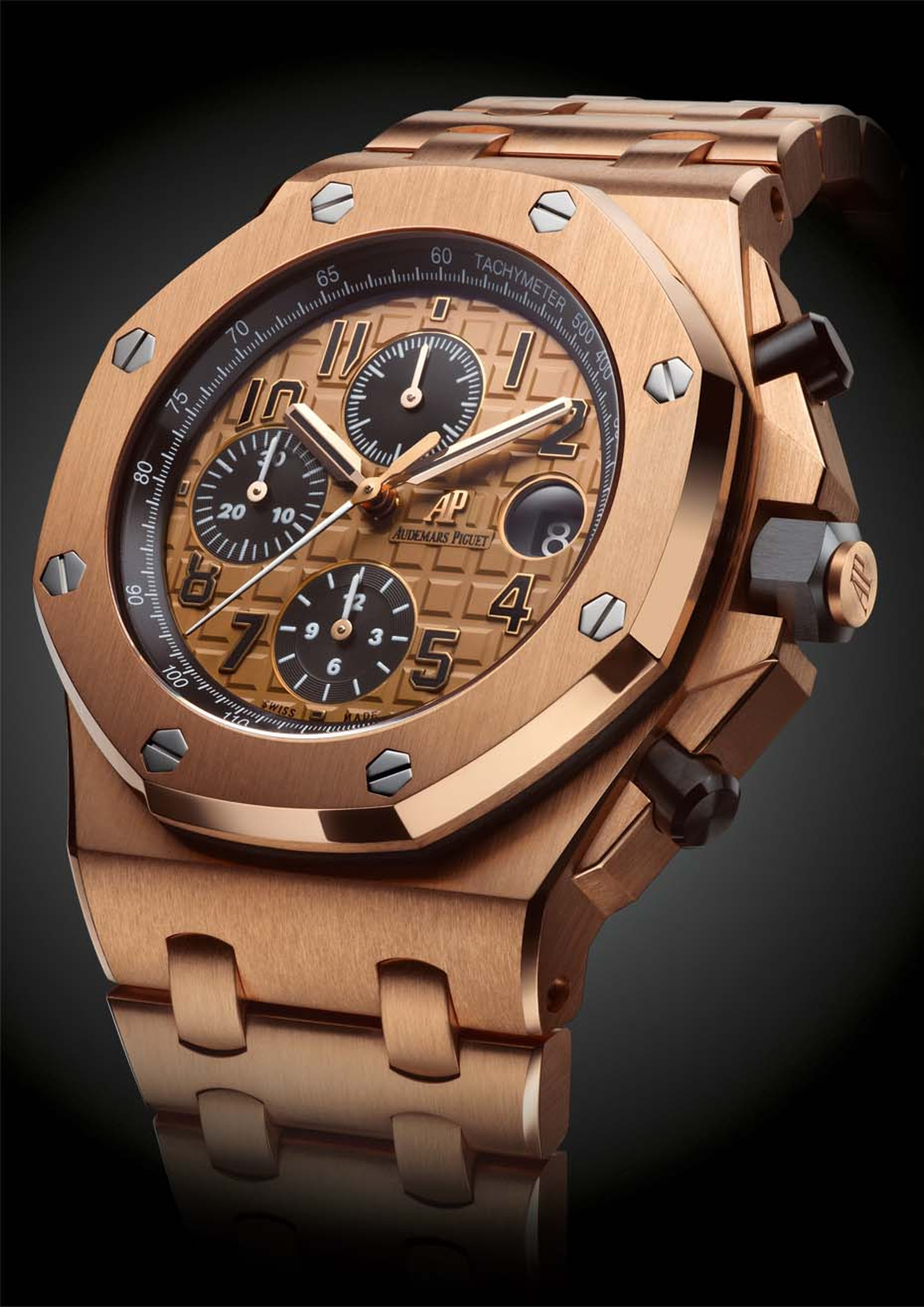 Audemars Piguet Royal Oak Offshore chronograph watch in pink gold with a 'Méga Tapisserie' pattern dial and pink gold bracelet (£50,400).