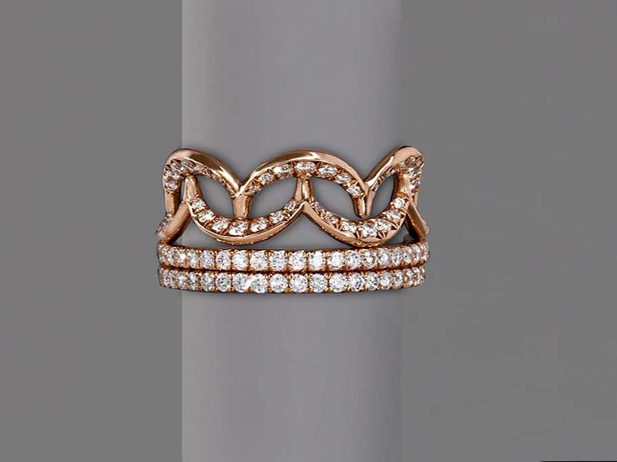 Jado Crown collection interlocking ring in gold with diamonds.