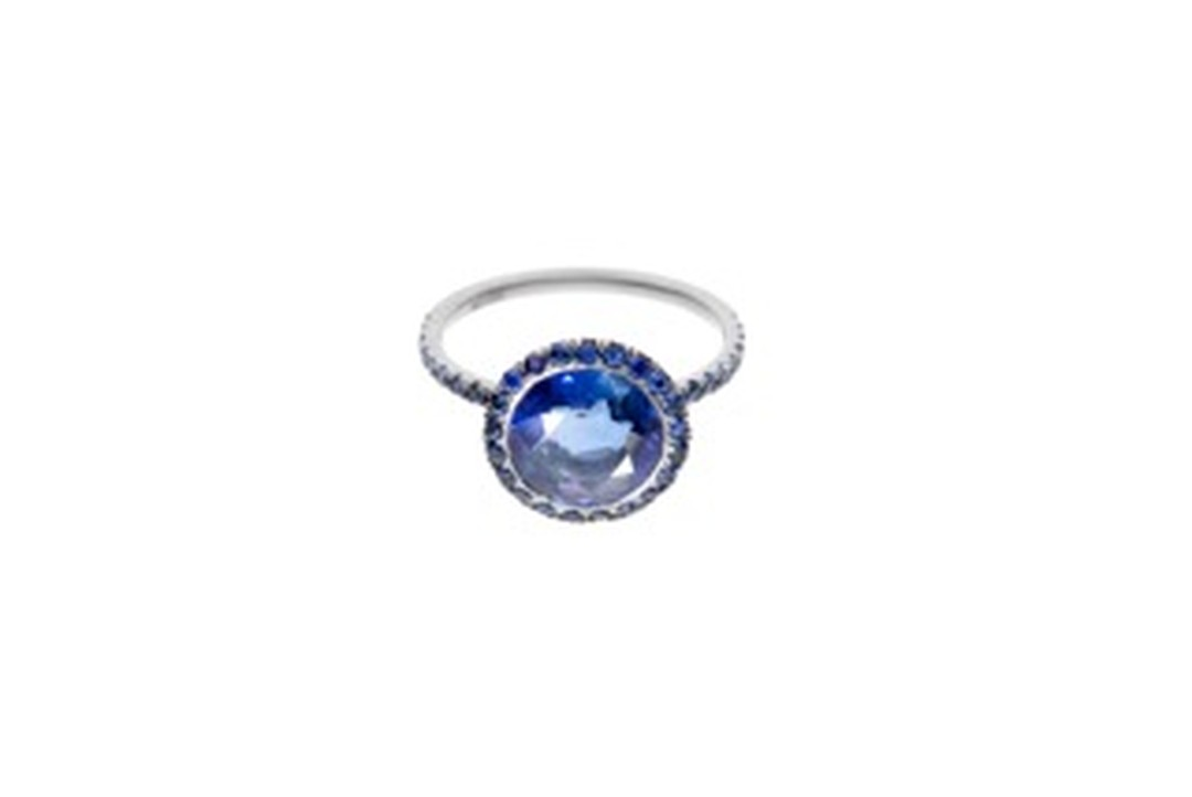 William Welstead ring featuring a central sapphire surrounded by a pavé of sapphires. Available exclusively from Dover Street Market.
