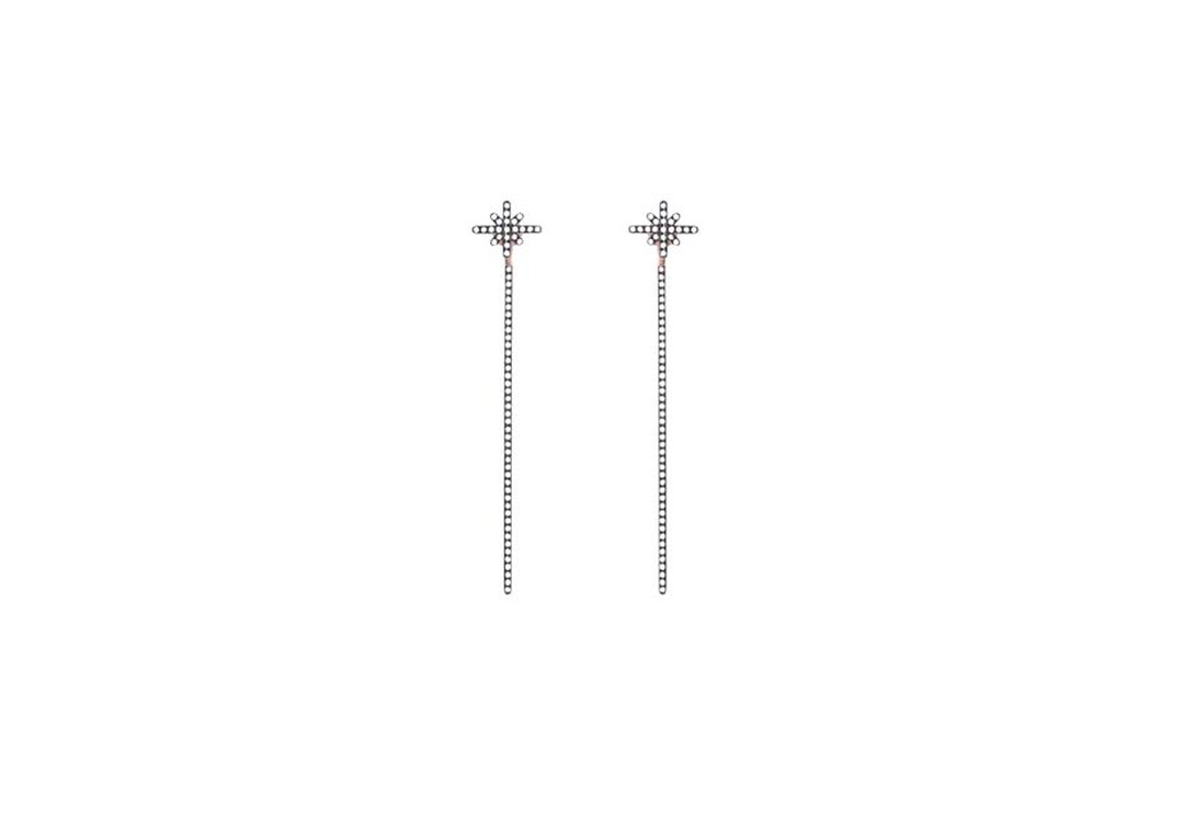 Diane Kordas earrings feature a white diamond Starburst stud and a white diamond bar at the back, for a modern update on the drop earring (£4,160).
