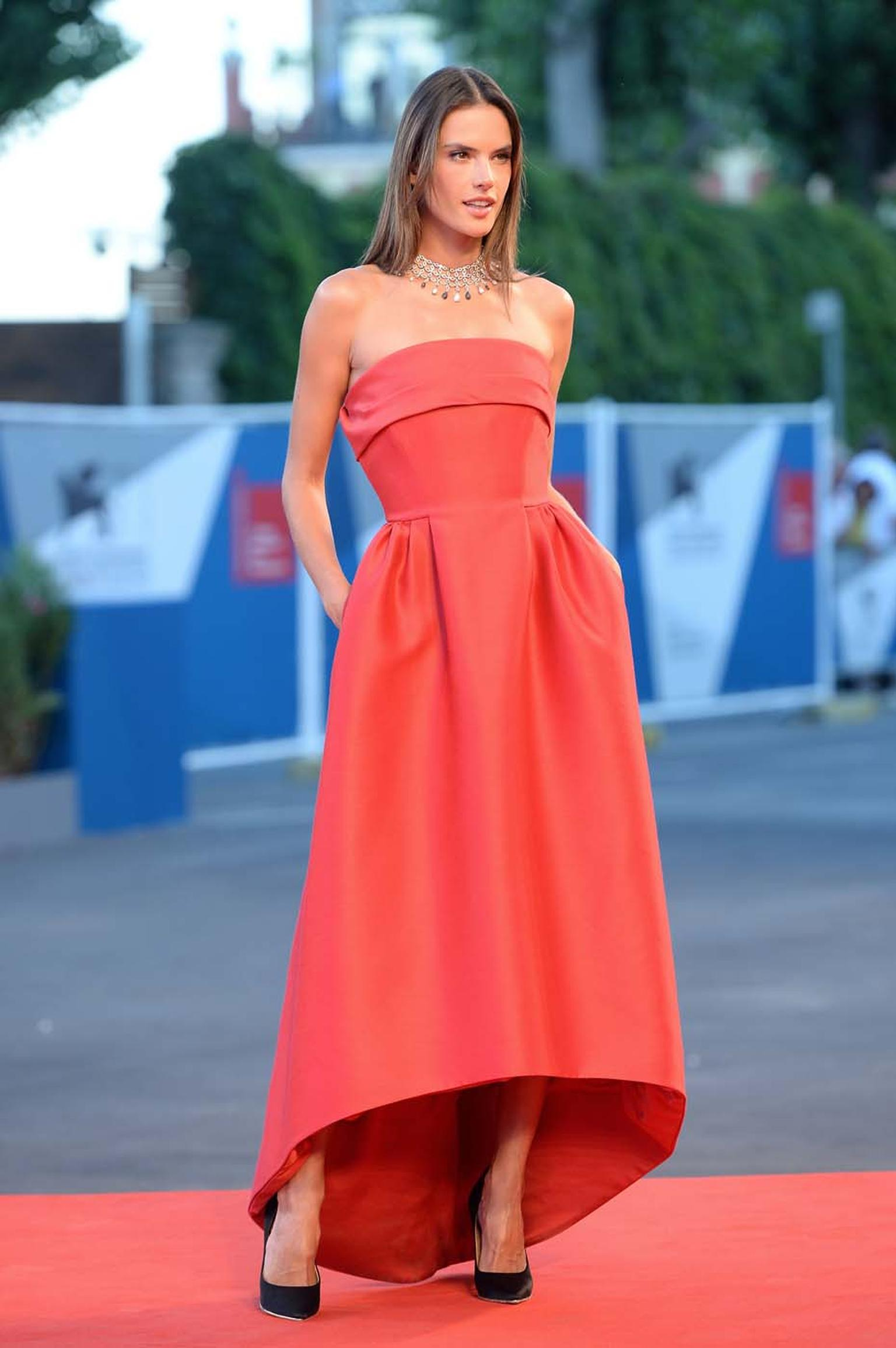 Alessandra Ambrosio looked picture perfect in a red gown and jewellery from the Chopard High Jewellery Collection at the premiere of La Rancon De La Gloire on the second day of the Venice Film Festival.