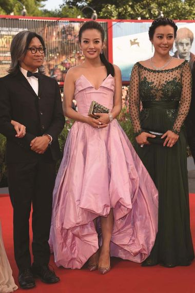 Director Peter Chan, actress Zhao Wei wearing a Jaeger-LeCoultre Reverso Cordonnet Neva watch and actress Hao Lei attend the Opening Ceremony of the 2014 Venice Film Festival.