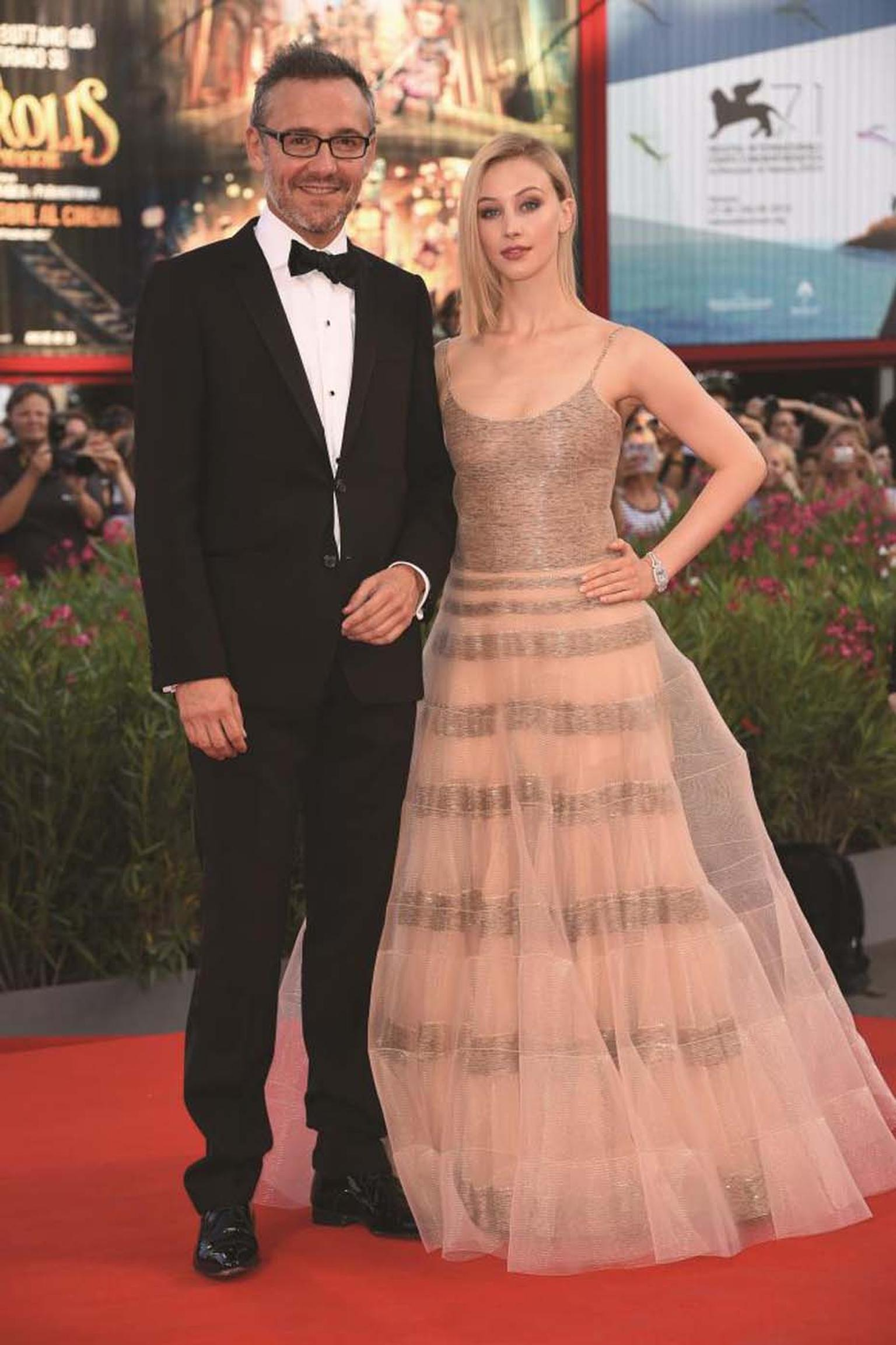 Jaeger-LeCoultre Communication Director Laurent Vinay and actress Sarah Gadon wearing the Jaeger-LeCoultre Reverso Cordonnet watch during the Venice Film Festival.