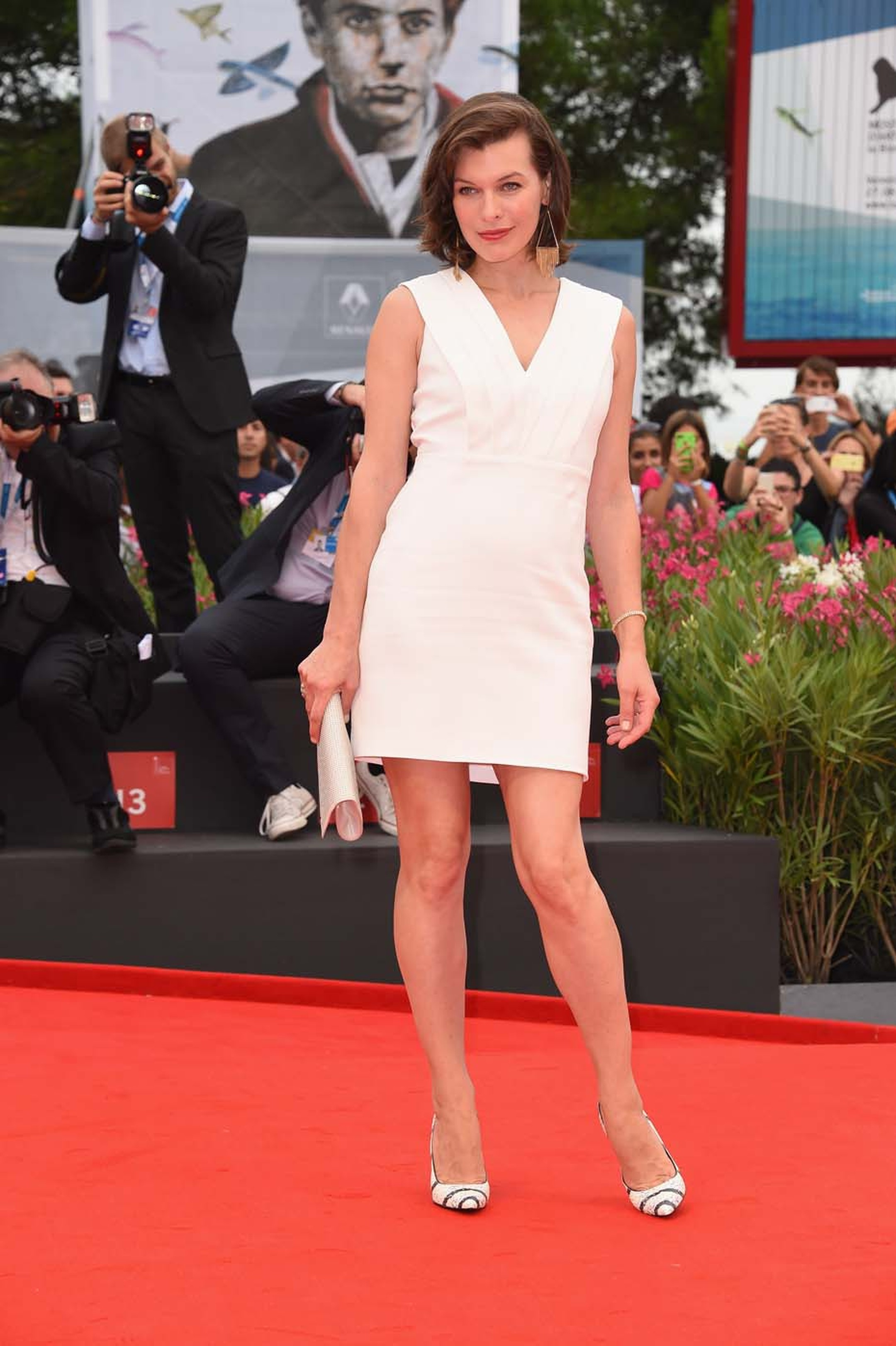 Actress Milla Jovovich wears the Jaeger-LeCoultre 101 Queen's watch while attending the Cymbeline Premiere at the Venice Film Festival.