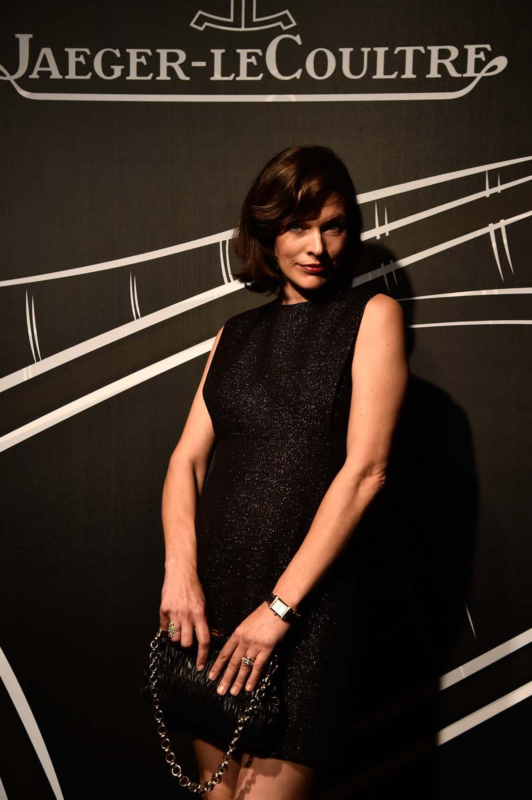 Milla Jovovich strikes a pose wearing a Jaeger-LeCoultre watch during the 2014 Venice Film Festival's Gala Dinner.