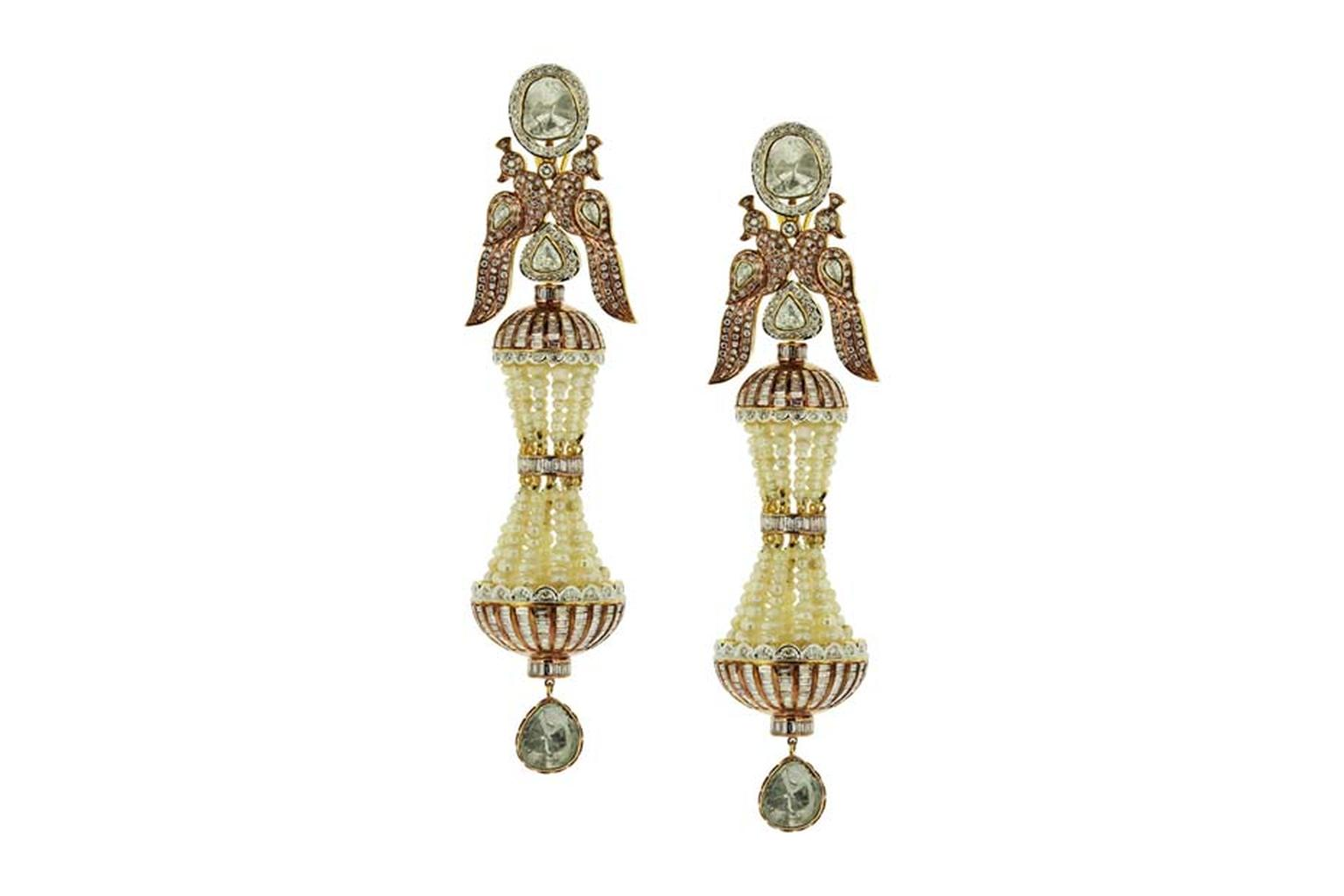 Birdhichand Ghanshyamdas Aks collection Peacock earrings inspired by minarets, featuring studded pearls and uncut and brilliant-cut diamonds.